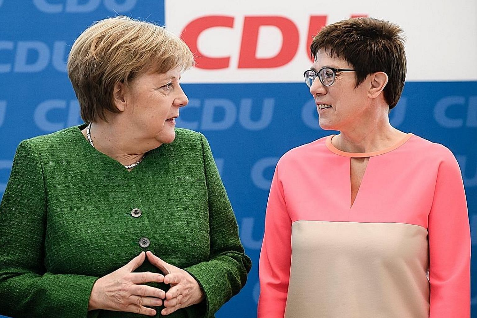 German Chancellor Angela Merkel with her close confidante Annegret Kramp-Karrenbauer at the CDU's headquarters in Berlin yesterday. The latter is strongly tipped to succeed Dr Merkel eventually.