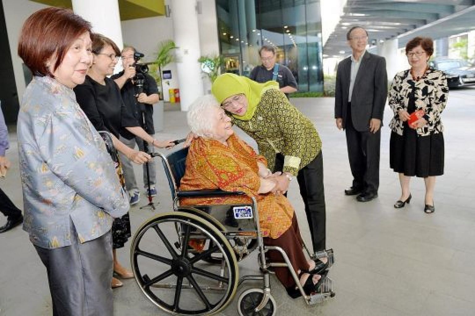 President Halimah Yacob greeting Mrs Urmila Nathan, widow of former president S R Nathan, at the Singapore University of Social Sciences yesterday, as Mrs Nathan's guest, businesswoman Jennie Chua (left), university president Cheong Hee Kiat (second