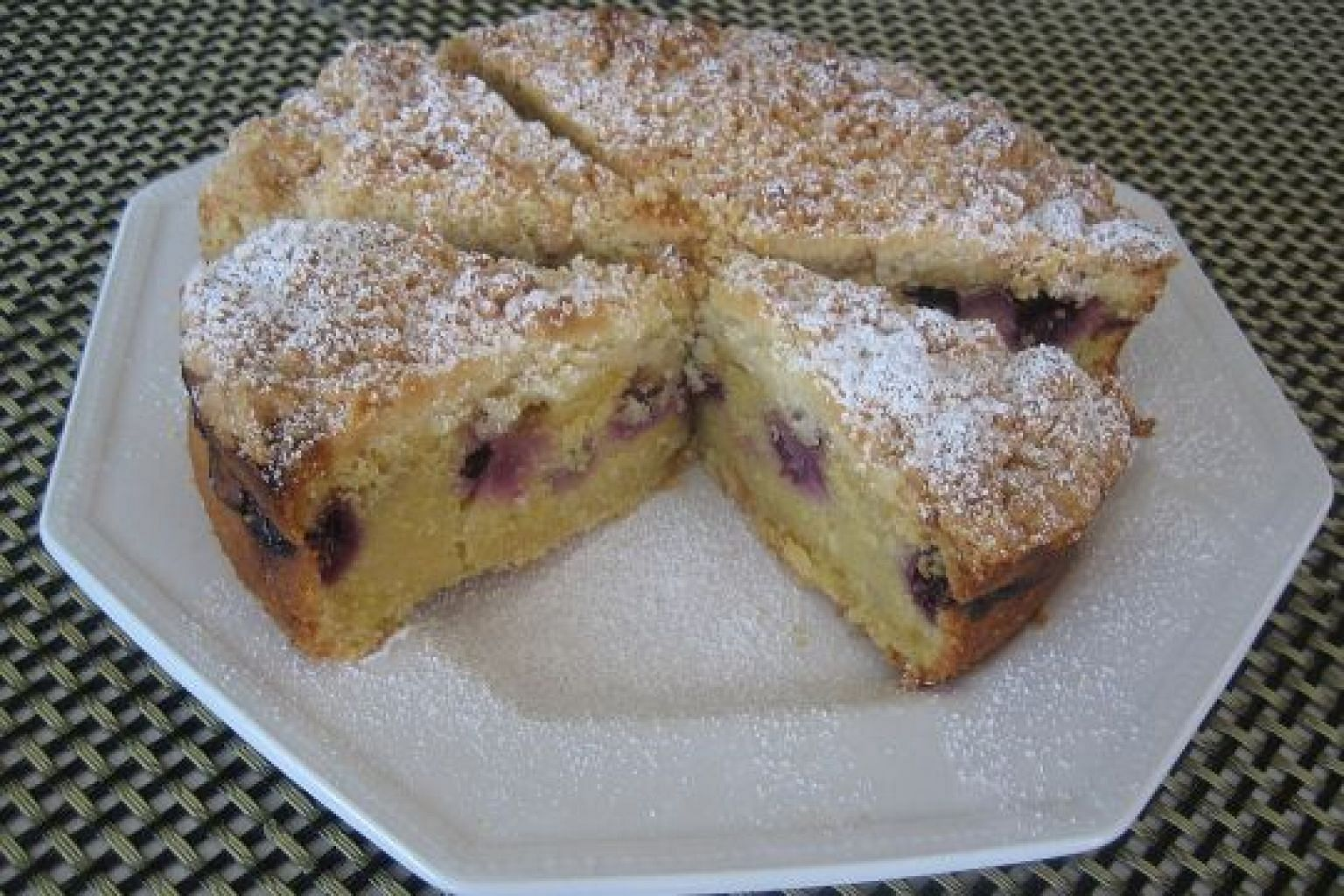 The polenta adds extra texture in the cake to complement the crumble topping.