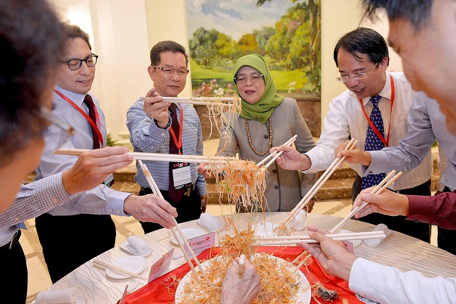 The Chingay parade may be over, but the festive fun continued at the Istana yesterday, with President Halimah Yacob thanking key contributors of this year's parade by inviting them to lunch and joining them to toss yusheng for good fortune. With her