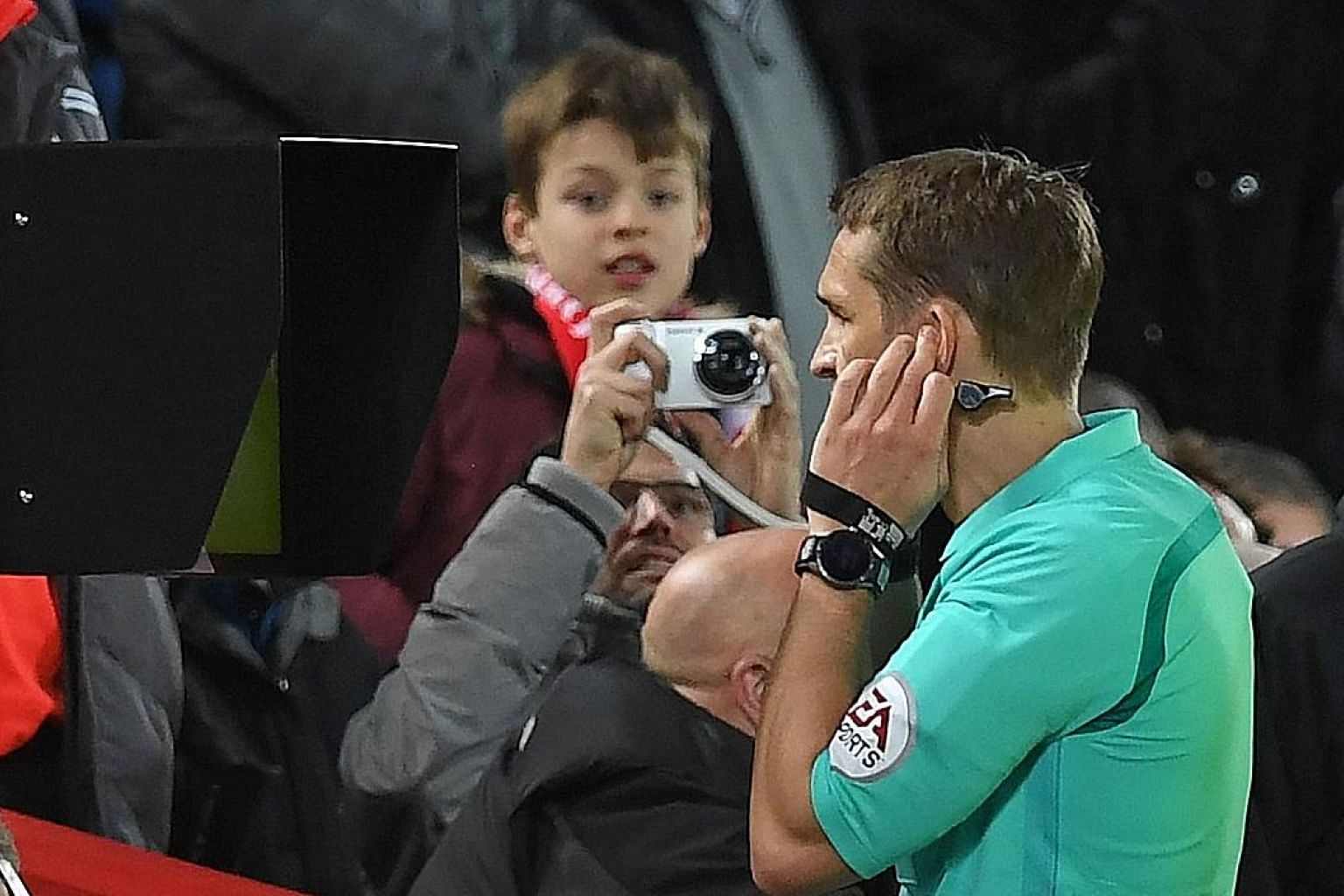 Referee Craig Pawson checking the pitchside screen after speaking to the VAR before giving Liverpool a penalty during the FA Cup match between Liverpool and West Bromwich Albion at Anfield in January.