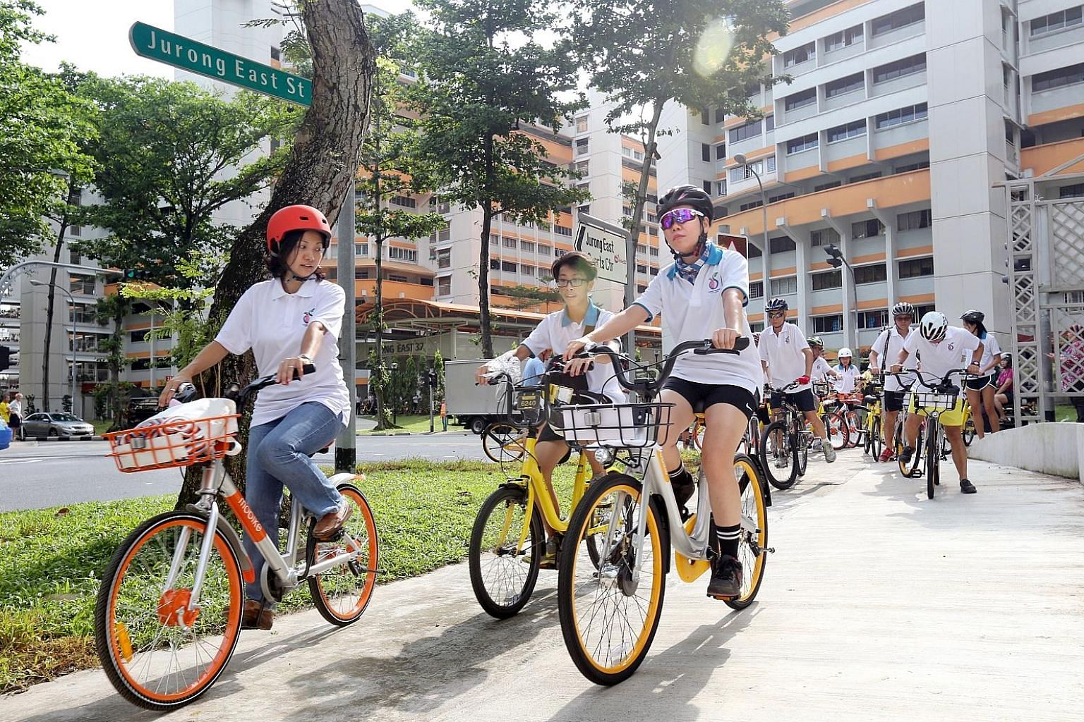 """Grassroots leaders cycling with residents in Jurong East last April. In Parliament yesterday, Mr Chan Chun Sing said government agencies, including grassroots organisations under the PA, would work with both grassroots advisers and opposition MPs """"on"""