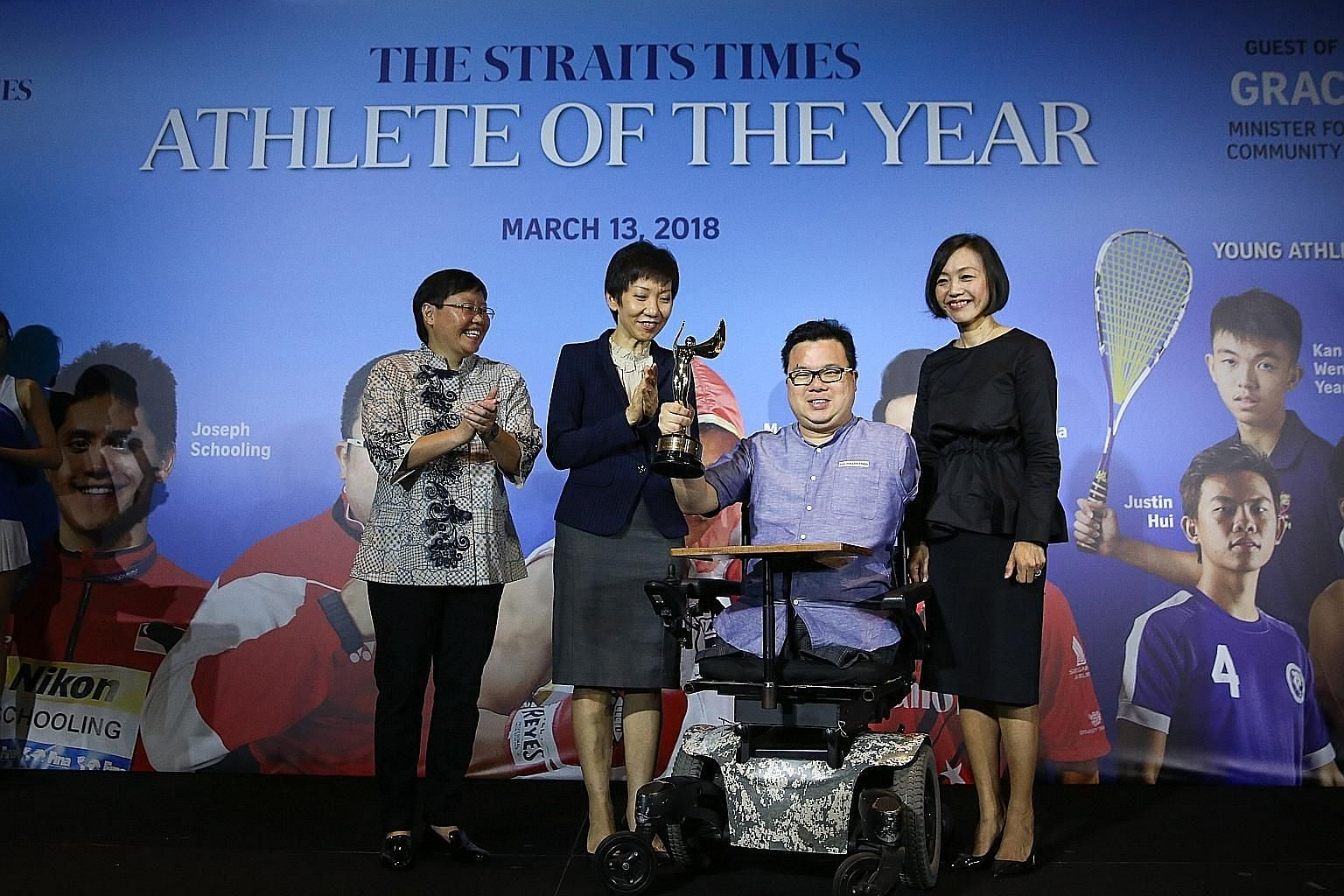 Para-paddler Jason Chee holding The Straits Times Athlete of the Year trophy at the Mandarin Orchard Singapore hotel yesterday. With him are (from left) ST sports editor Lee Yulin, Minister for Culture, Community and Youth Grace Fu and general manage