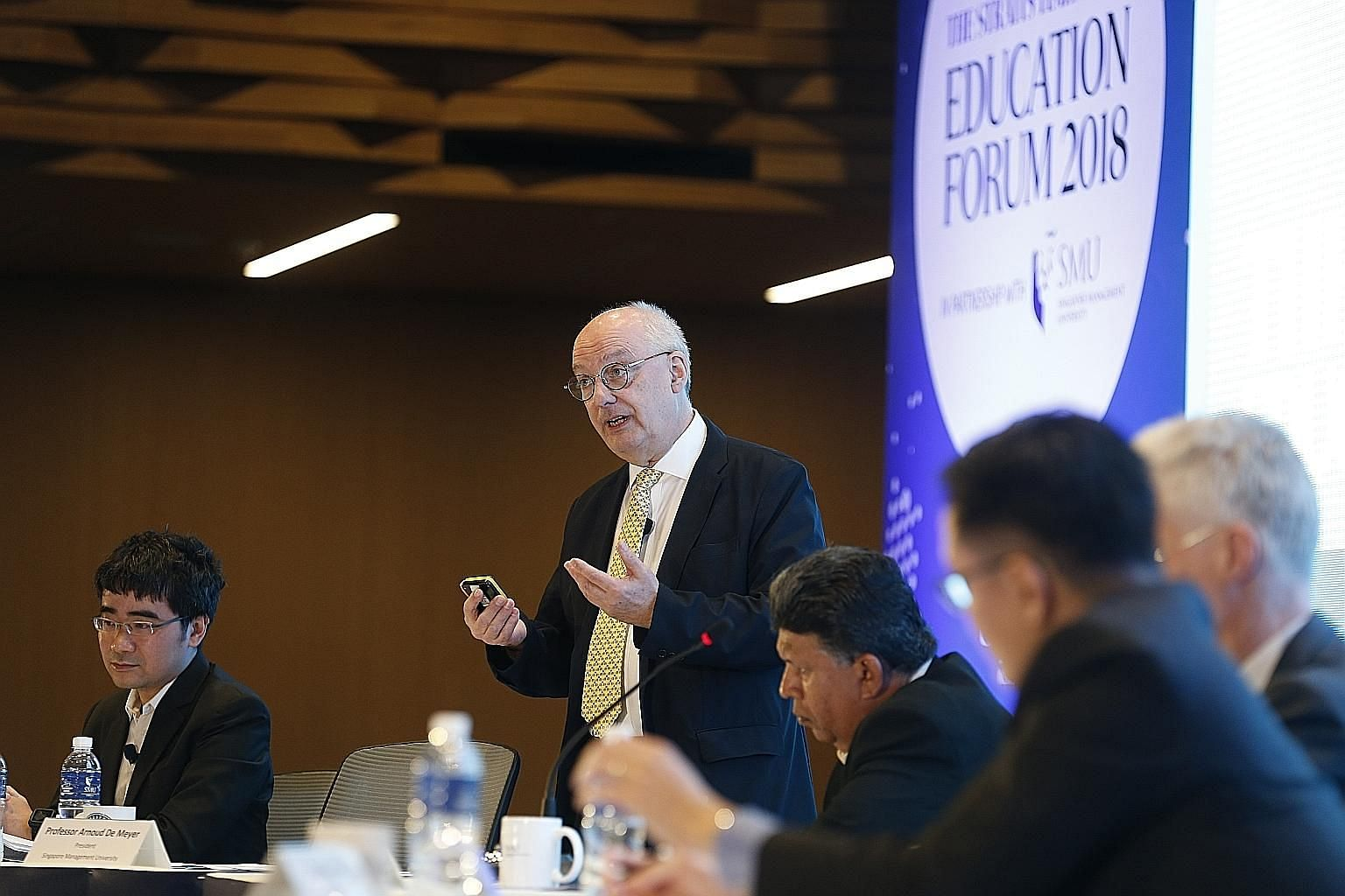 "From left: Singapore Management University law dean Goh Yihan and SMU president Arnoud De Meyer argued against the motion ""You don't need a degree to succeed in life"" at the Straits Times Education Forum yesterday. On the opposing team were OECD dire"