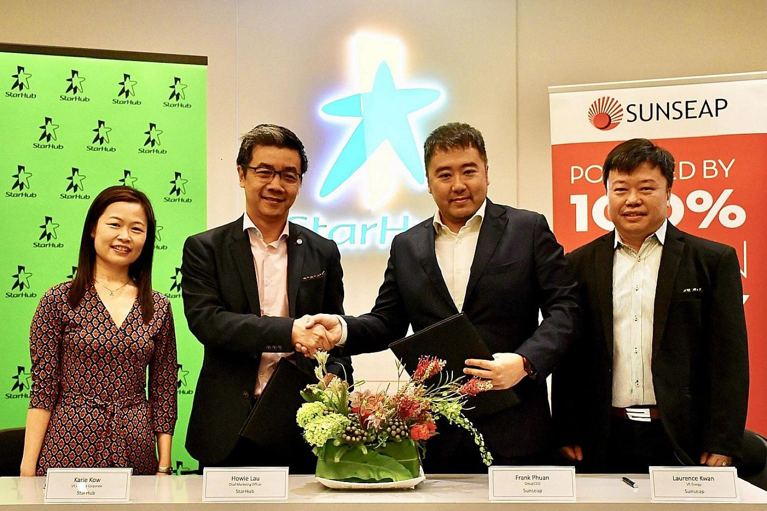 (From left) StarHub's vice-president of corporate finance Karie Kow and chief marketing officer Howie Lau with Sunseap's co-founder and chief executive Frank Phuan and vice-president of energy Laurence Kwan. StarHub and Sunseap will offer customers a