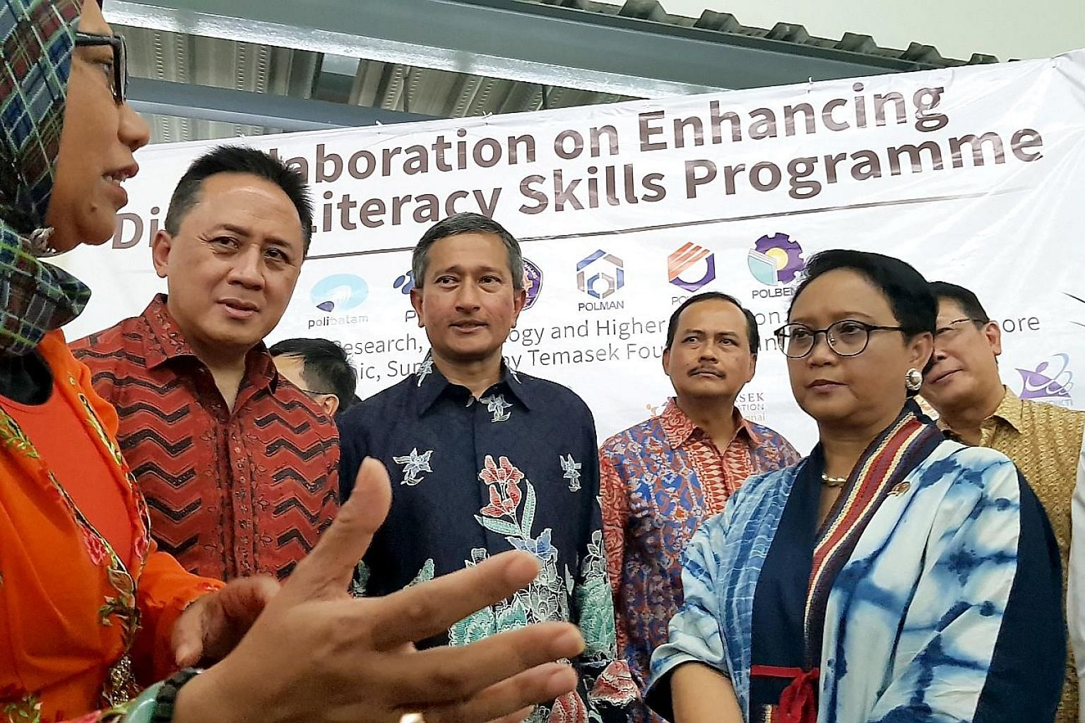 Singapore Foreign Minister Vivian Balakrishnan and his Indonesian counterpart Retno Marsudi (in blue dress) on a tour of Nongsa Digital Park, which was launched yesterday. With them were (from left) Dr Paristiyanti Nurwardani of the Indonesian Minist