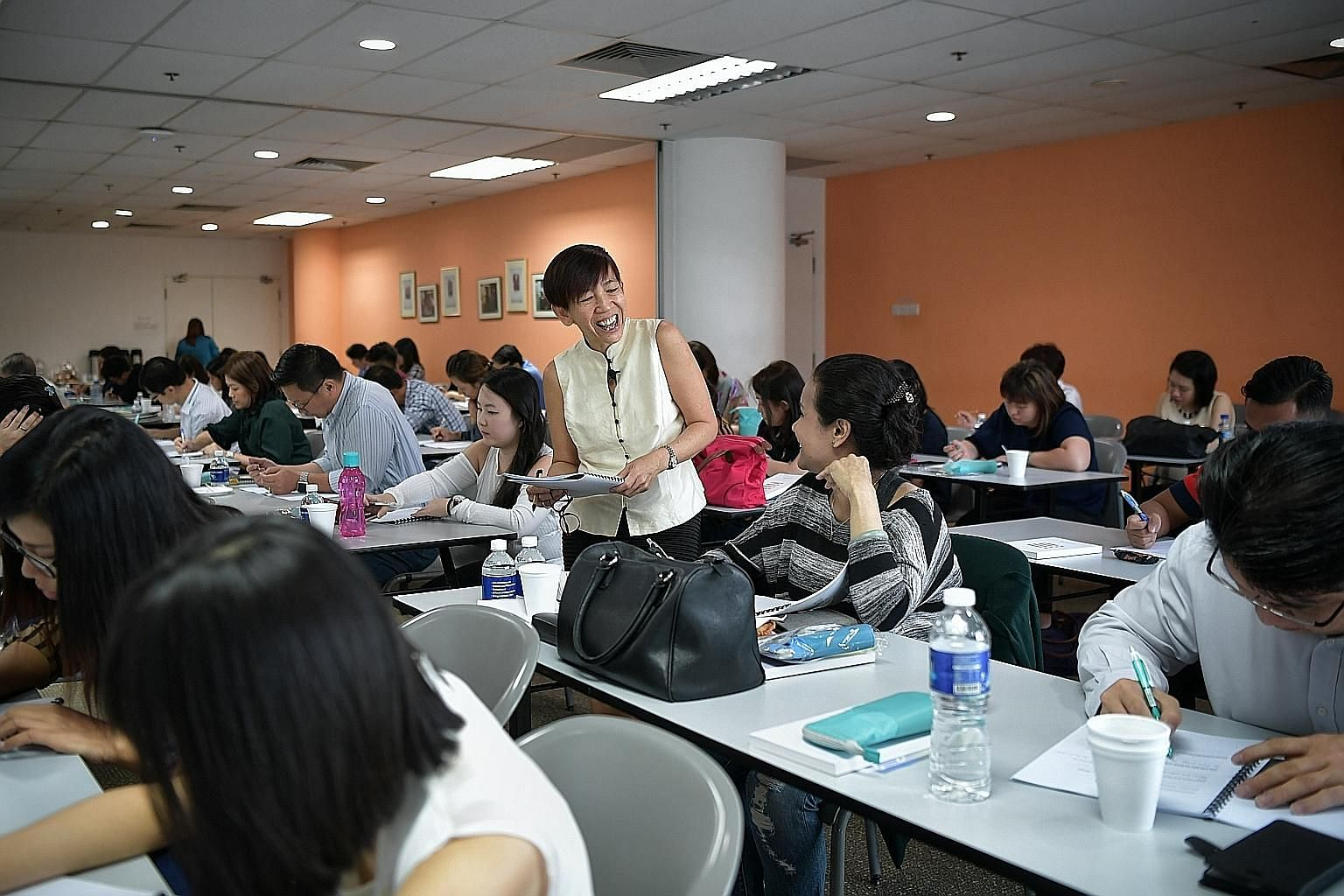 Straits Times journalist Angelina Choy conducting the ST English Masterclass last Friday. Those who have SkillsFuture Credit can now use it to offset the course fee of $499 when they sign up for the masterclass.