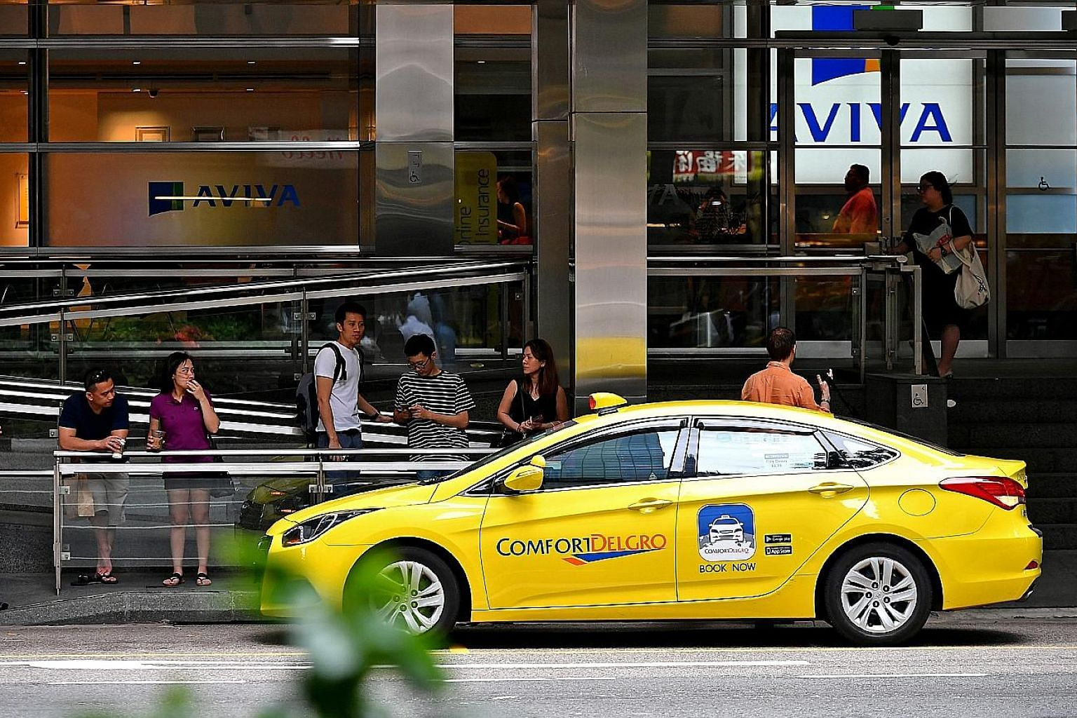 ComfortDelGro drivers were offered the option last month of signing up with JustGrab - Grab's flat fee ride-hailing platform.