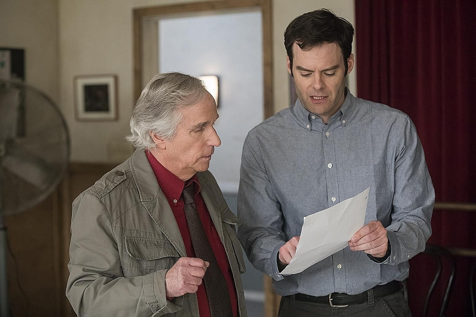 Bill Hader as Barry (above right, with Henry Winkler), an assassin who wants to be an actor. Veerle Baetens (left) is Mie, a woman who has short-term amnesia.