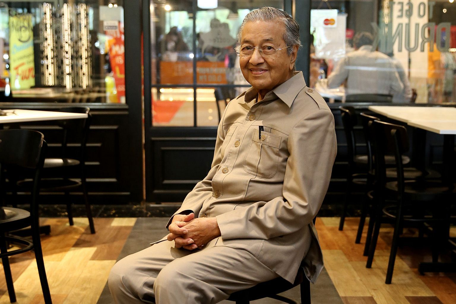 Tun Dr Mahathir Mohamad at The Loaf bakery-cafe in Cyberjaya last Wednesday. He now leads Malaysia's opposition alliance and his schedule in the run-up to the general election has been punishing.