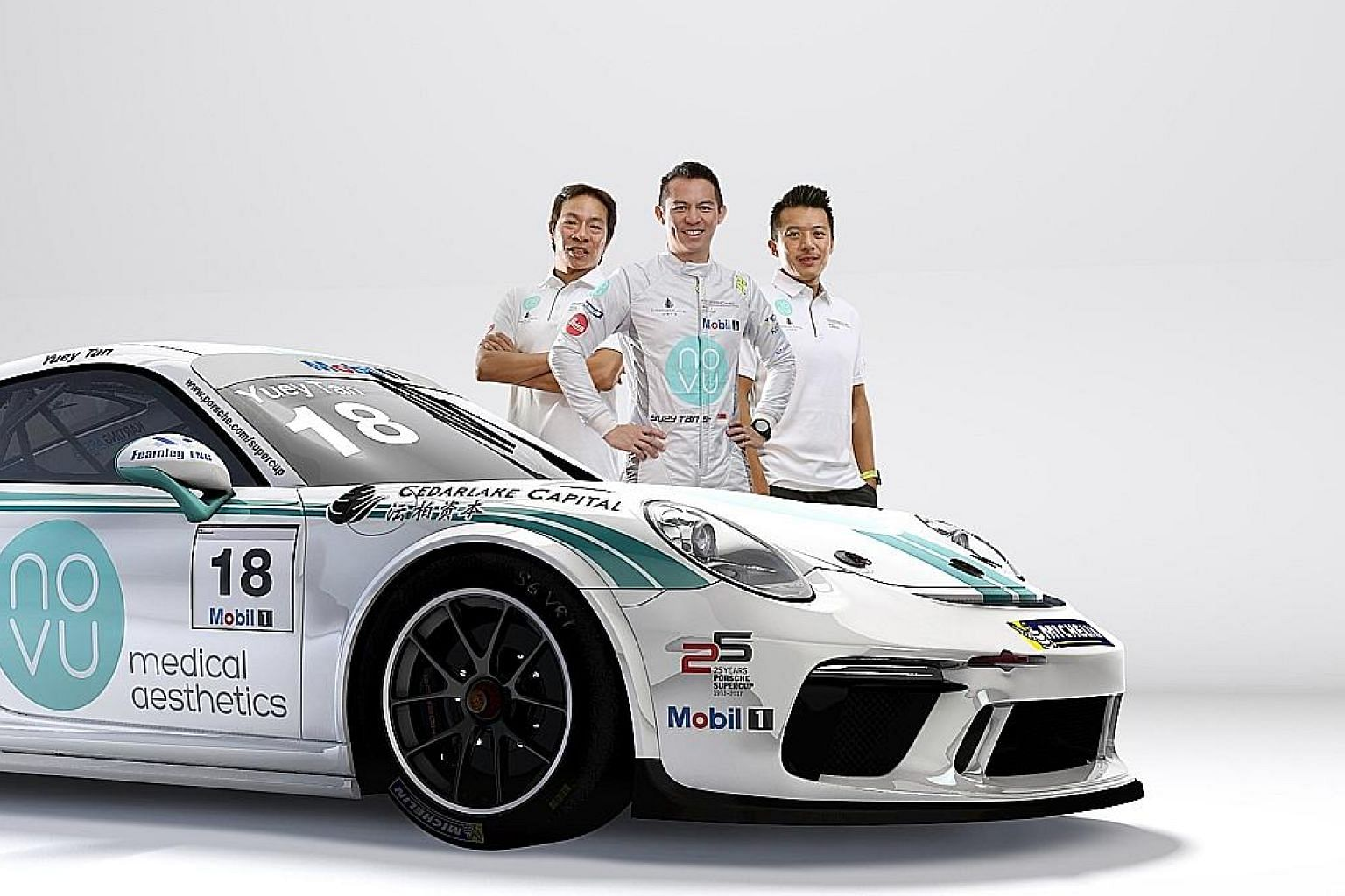 Race-car driver Yuey Tan flanked by his sponsors, cousins Terence Loh (left) and Nelson Loh. He knows that it will be tough to compete without Novu's backing.