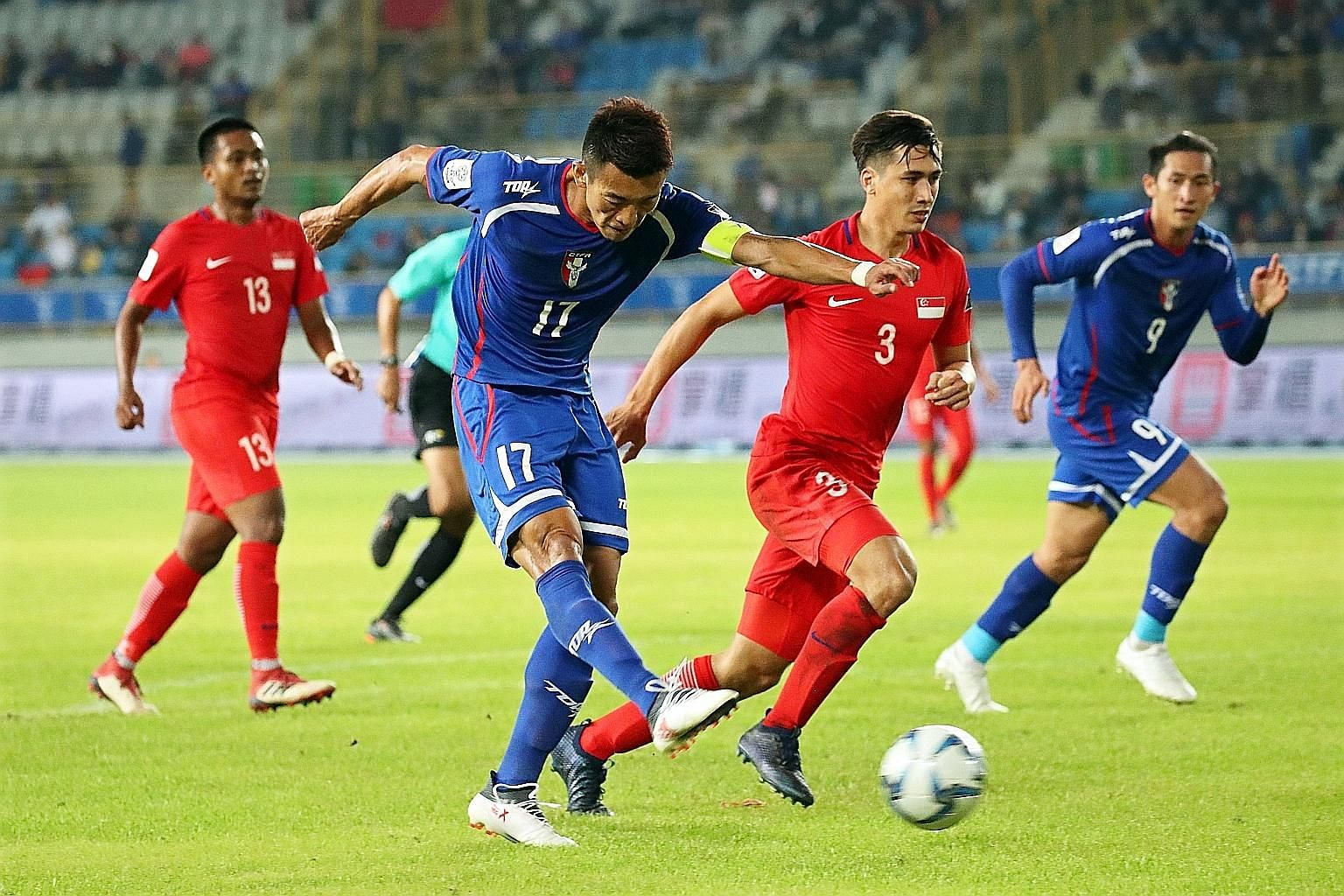 Chinese Taipei captain Chen Po-liang getting to the ball before Singapore's Anders Aplin to score the only goal of the Asian Cup Group E qualifier in Taipei last night.