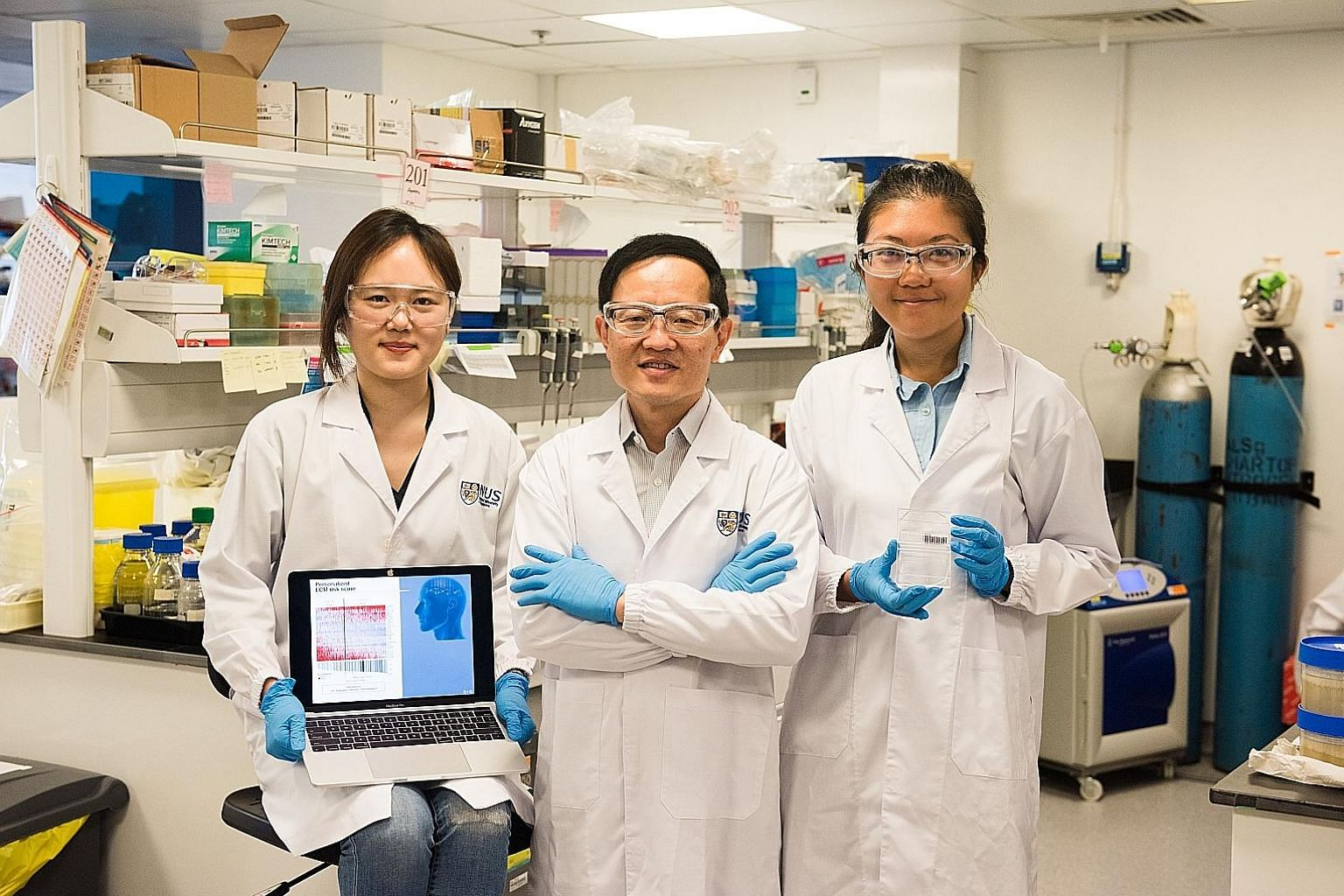 From left: PhD student Lim Su Bin from the NUS Graduate School for Integrative Sciences and Engineering; Professor Lim Chwee Teck, principal investigator of the Mechanobiology Institute; and Dr Khoo Bee Luan, senior postdoctoral associate at the Sing