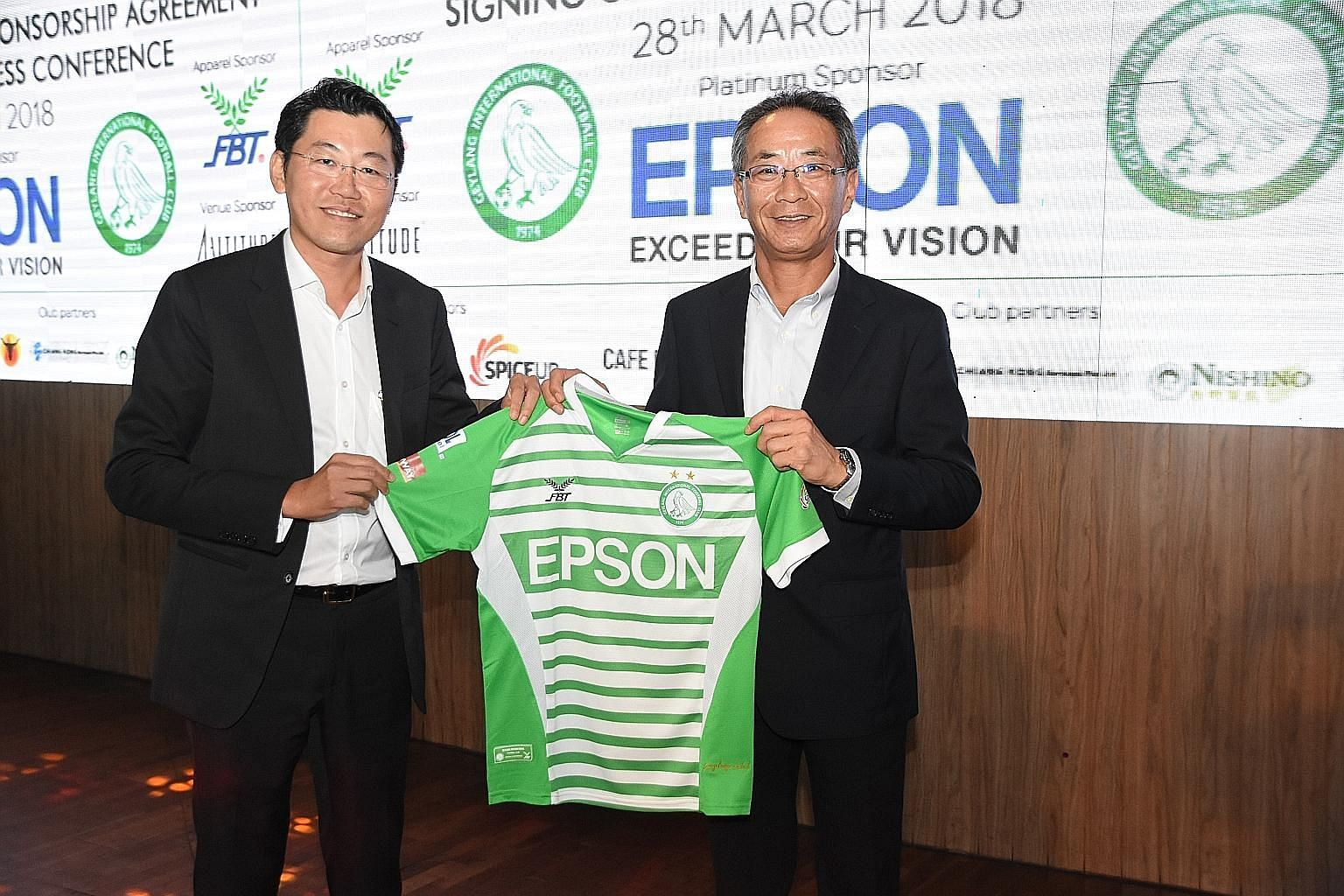 """Geylang International chairman Ben Teng (far left) and Epson Singapore managing director Toshimitsu Tanaka inked a one-year extension, understood to be worth $100,000, to their sponsorship deal at 1-Altitude yesterday. Teng said: """"It's not easy to fi"""