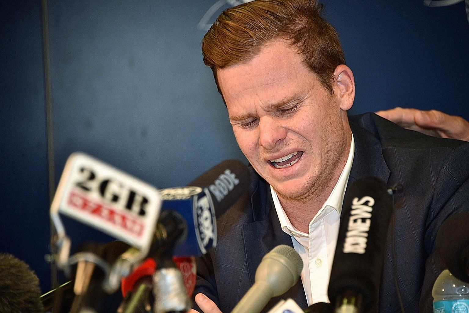 Steve Smith overcome by emotion at Sydney Airport, where the former Australian skipper failed to complete a news conference to apologise for his role in the ball-tampering scandal in South Africa. He lost his captaincy and was handed a 12-month suspe