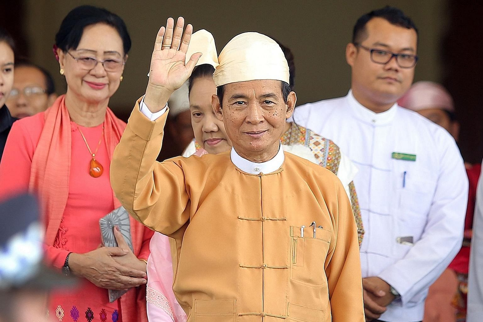 "Mr Win Myint, seen here after taking his oath of office in Naypyitaw yesterday, said he would focus on the rule of law, national reconciliation and ""amending the Constitution to build a democratic federal union""."