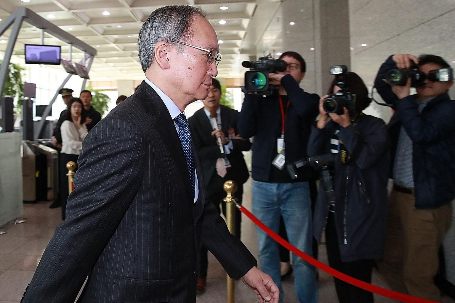 Japan's Ambassador to South Korea Yasumasa Nagamine arriving at the Foreign Ministry in Seoul yesterday after being summoned by South Korea.