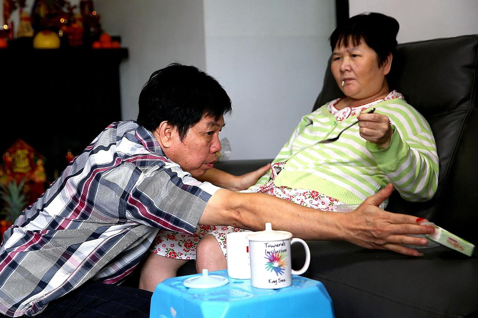 Madam Ang Liu Kiow, seen here with her husband Leong Loon Wah, was hit by an e-scooter and suffered severe head injuries.