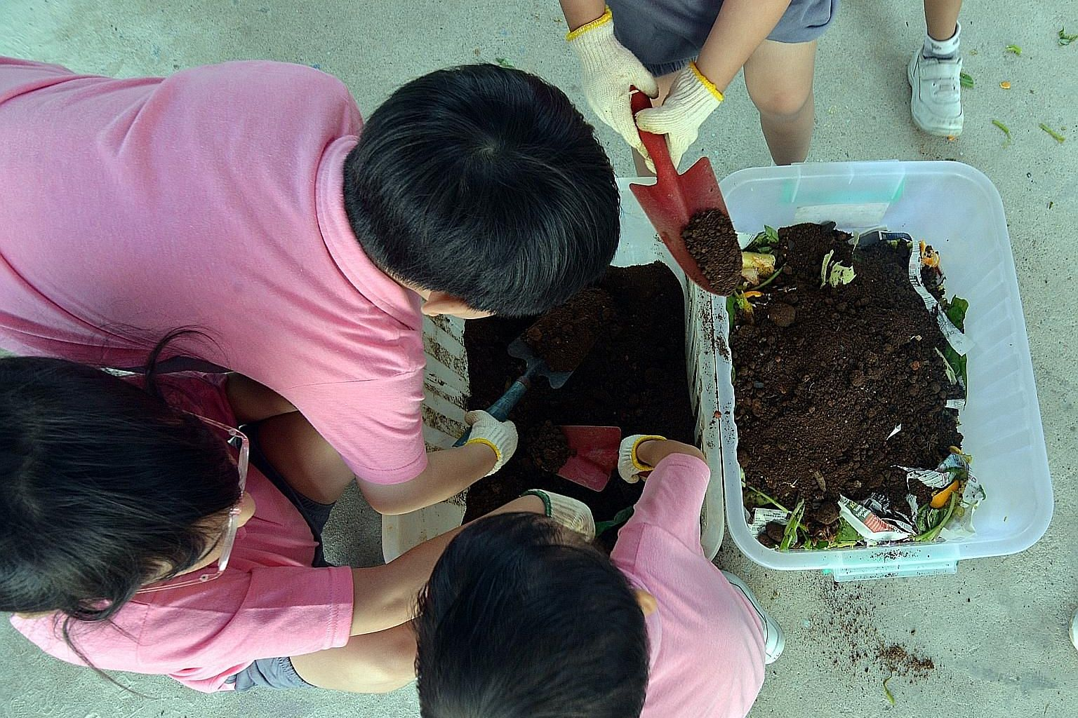 Pre-schoolers working on a compost bin with food waste they collected. Figures from the National Environment Agency show that the amount of food waste generated in Singapore has increased by about 40 per cent over the last 10 years.
