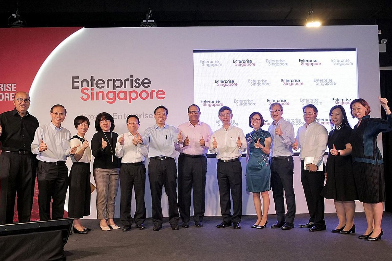 At yesterday's launch of Enterprise Singapore were (from left) assistant CEO Satvinder Singh, deputy CEO Ted Tan, assistant CEO Eunice Koh, assistant CEO Chew Mok Lee, senior adviser Chua Taik Him, CEO Png Cheong Boon, Minister for Trade and Industry