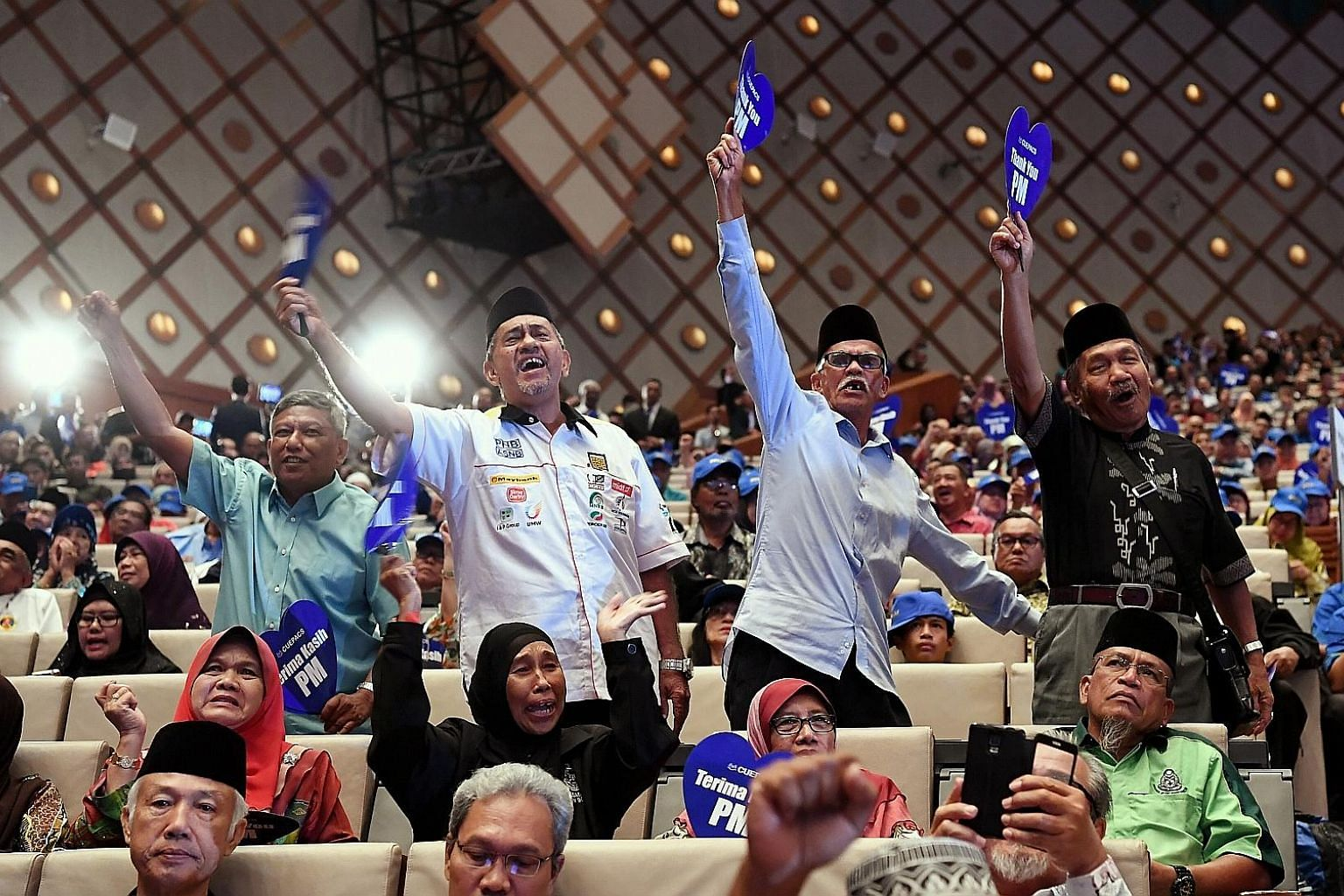 Civil service retirees cheering the announcement of a cash payment of RM750 (S$260) for them yesterday. Civil servants have traditionally been supporters of the ruling coalition.