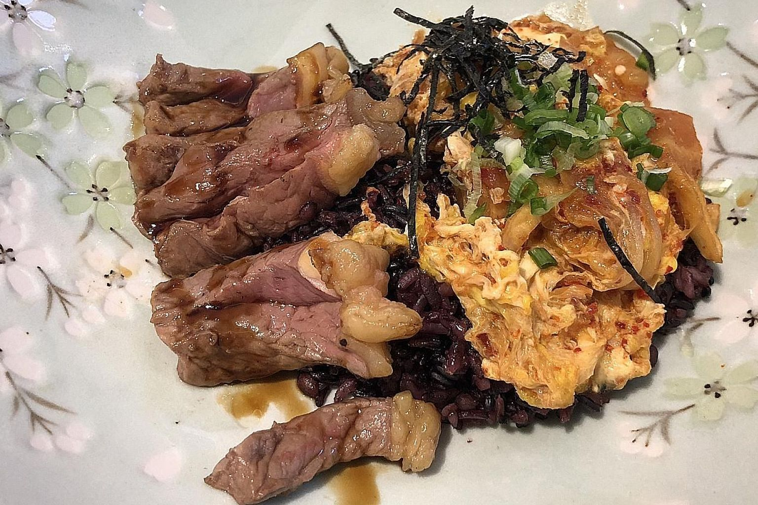 The Yes Sir! Yes Sir! bowl ($12) comes with sirloin steak, a purple multi-grain rice called japgokbap, kimchi omelette and a drizzle of teriyaki sauce.