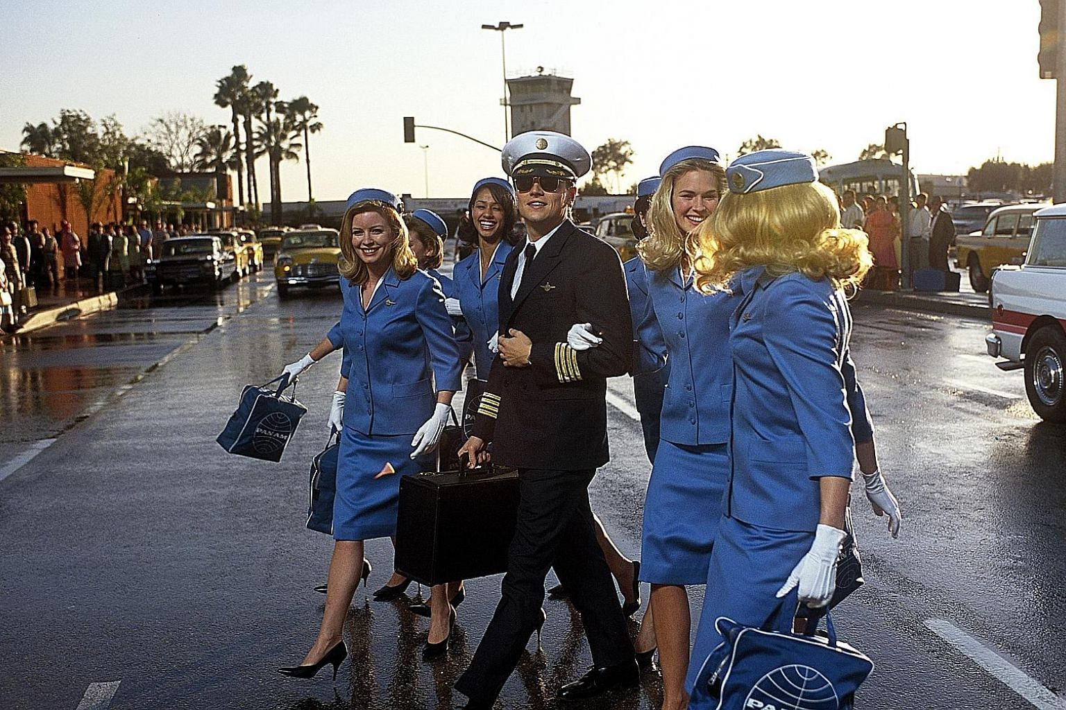 Just like Frank Abagnale Jr, the confidence trickster played by Leonardo DiCaprio (left) in the 2002 biopic Catch Me If You Can, the writer always felt he was one step away from being found out as a fraud.