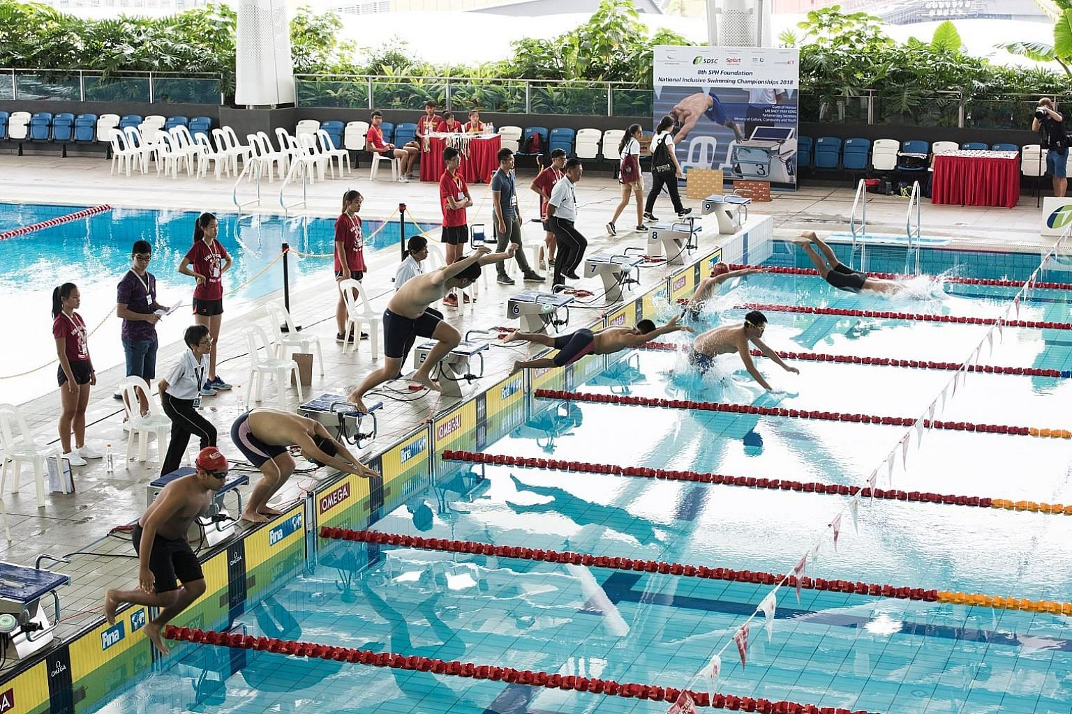 Competitors diving into the Tampines Swimming Complex pool at the National Inclusive Swimming Championships. This year's competition had swimmers with autism and Down syndrome taking part for the first time.