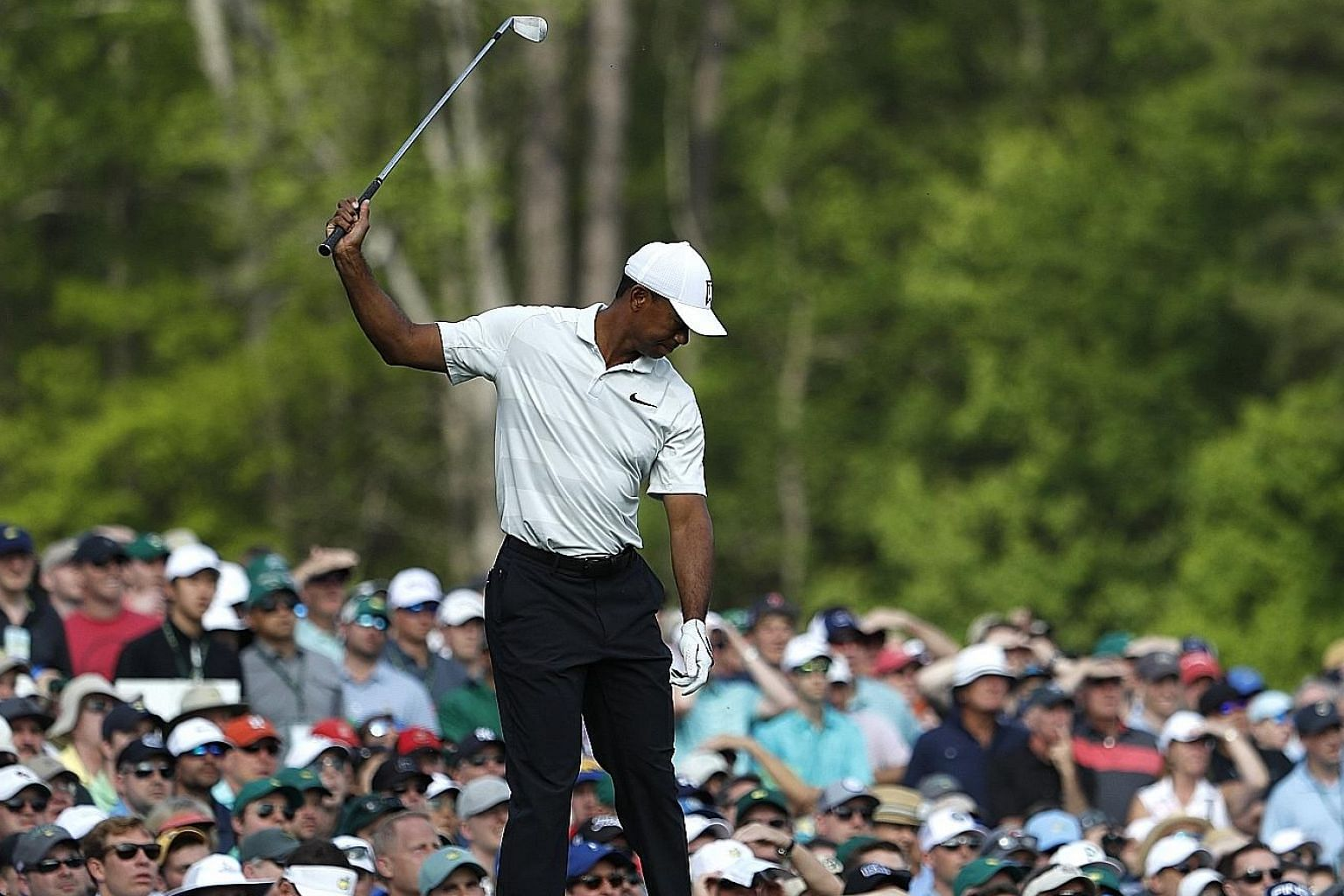 Tiger Woods venting his frustration after hitting a shot off the 12th tee during the second round at the Augusta National Golf Club on Friday. The four-time Masters winner, who is returning to form after recent back problems, chose to dwell on the br