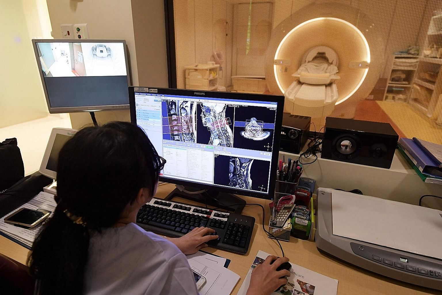 A radiographer at work at the Singapore General Hospital. The insurers said medical fees were the largest contributor to inpatient costs. Other factors included diagnostic procedures, drugs, prosthetics, and room and board.