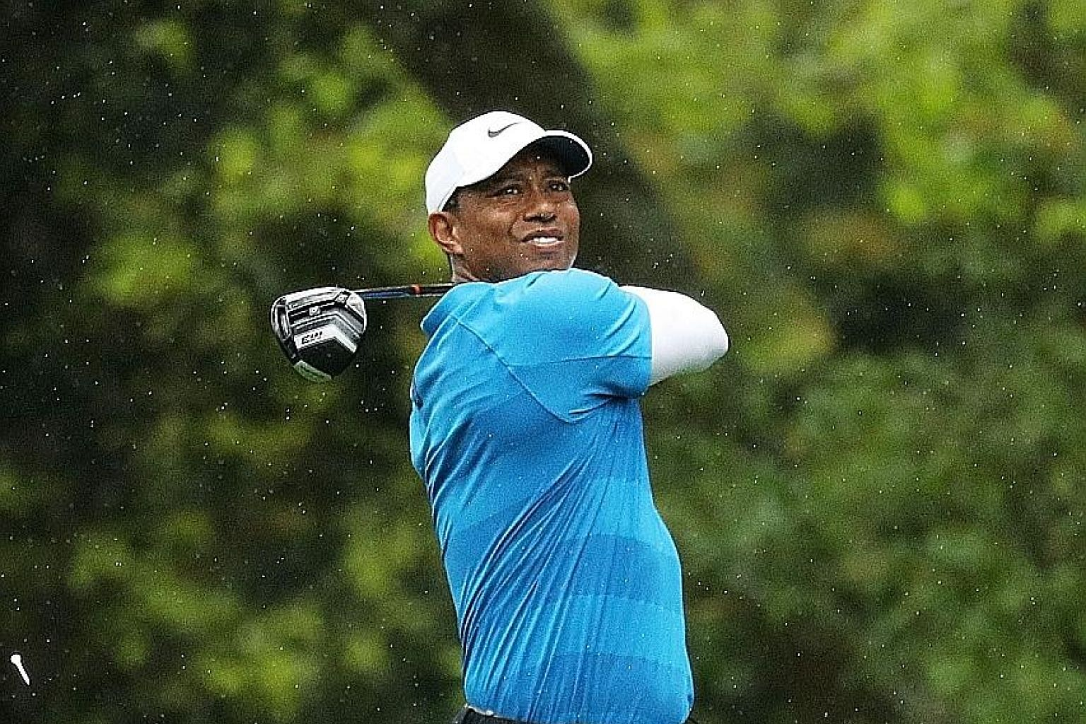 Four-time champion Tiger Woods finds himself hampered by wayward drives and poor approach shots at Augusta.