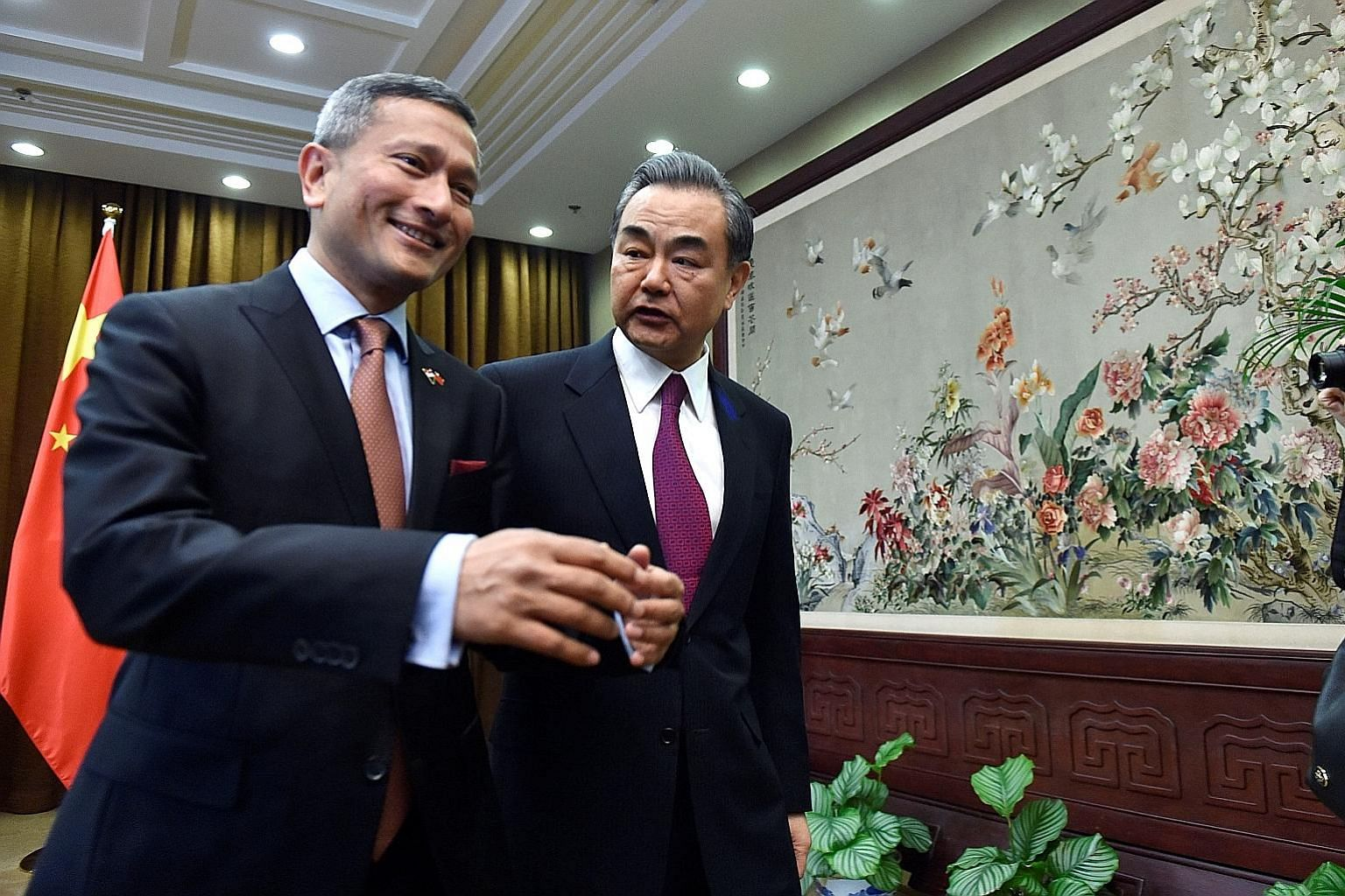 Foreign Minister Vivian Balakrishnan with China's Foreign Minister Wang Yi in Beijing yesterday. Both said they would defend free trade and multilateralism together at a time when protectionist tendencies are on the rise.