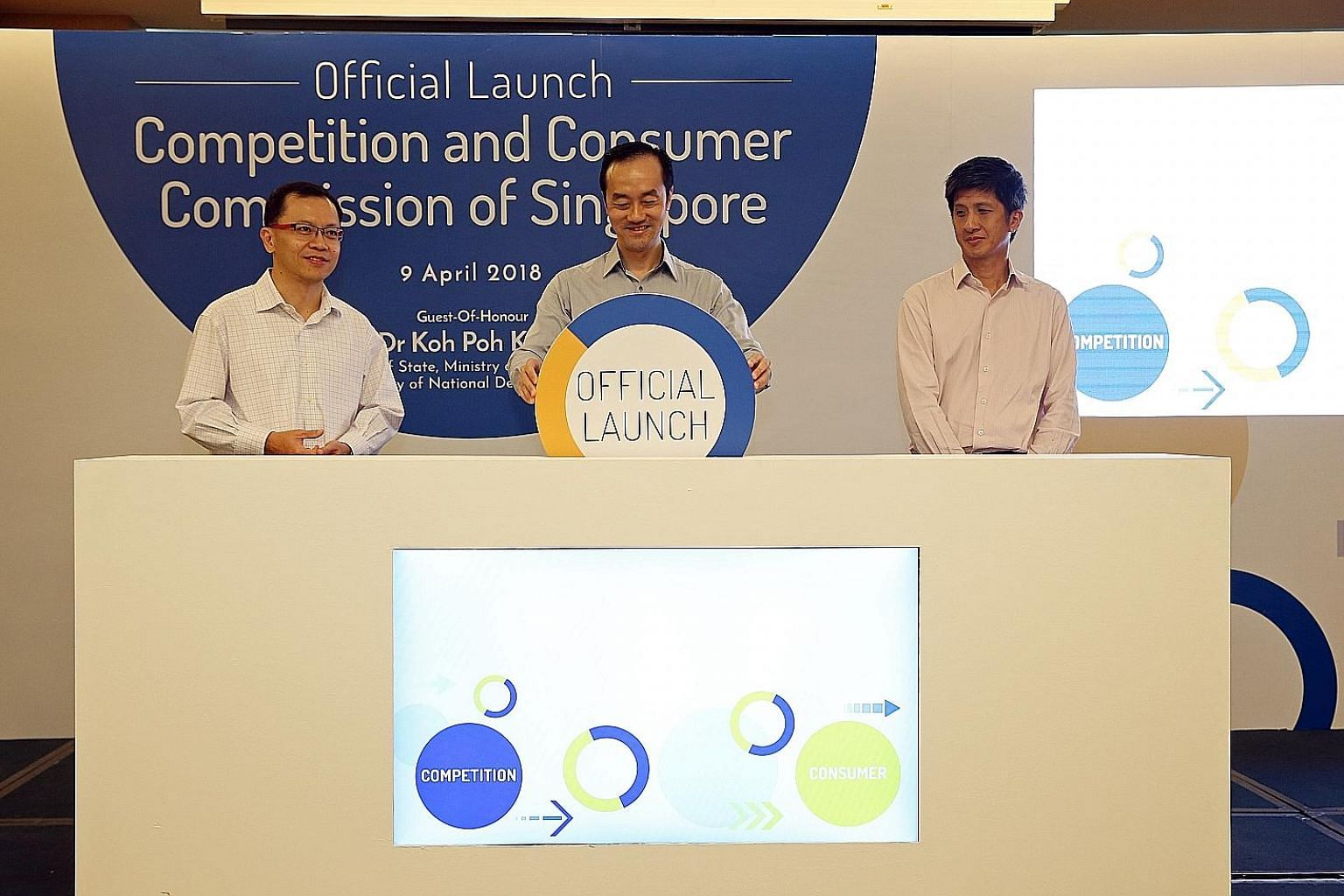 (From left) Competition and Consumer Commission of Singapore chairman Aubeck Kam, Senior Minister of State for Trade and Industry and National Development Koh Poh Koon, and CCCS chief executive Toh Han Li at the launch of the competition watchdog's n