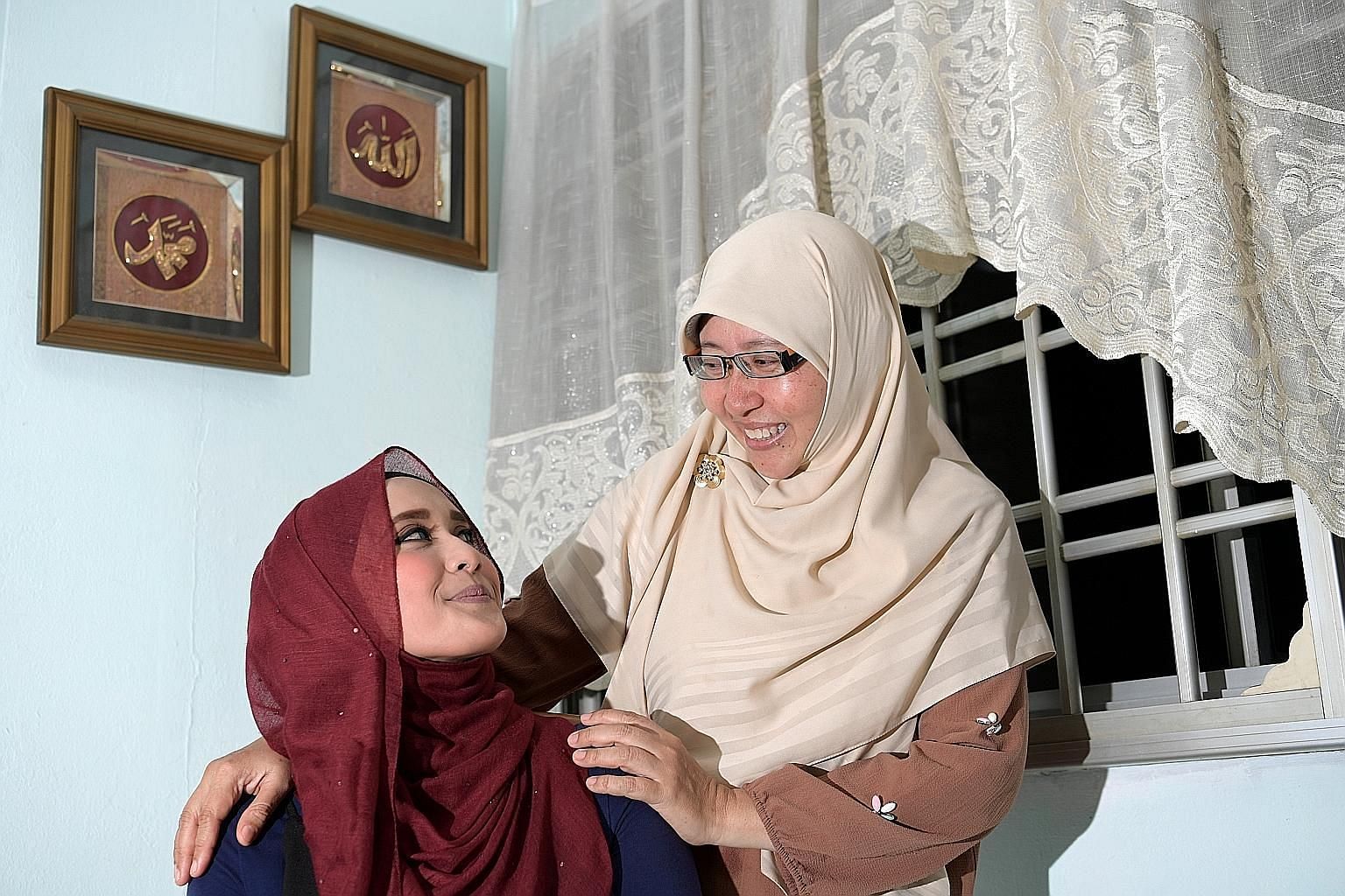 Miss Nur Diyana Abdul Aziz, who battled ovarian cancer as a 21-year-old, with her mother, Madam Noraidah Amin, a breast cancer survivor. Miss Nur Diyana, now 26, says cancer taught her to look beyond herself. She set a goal to forge a career in custo