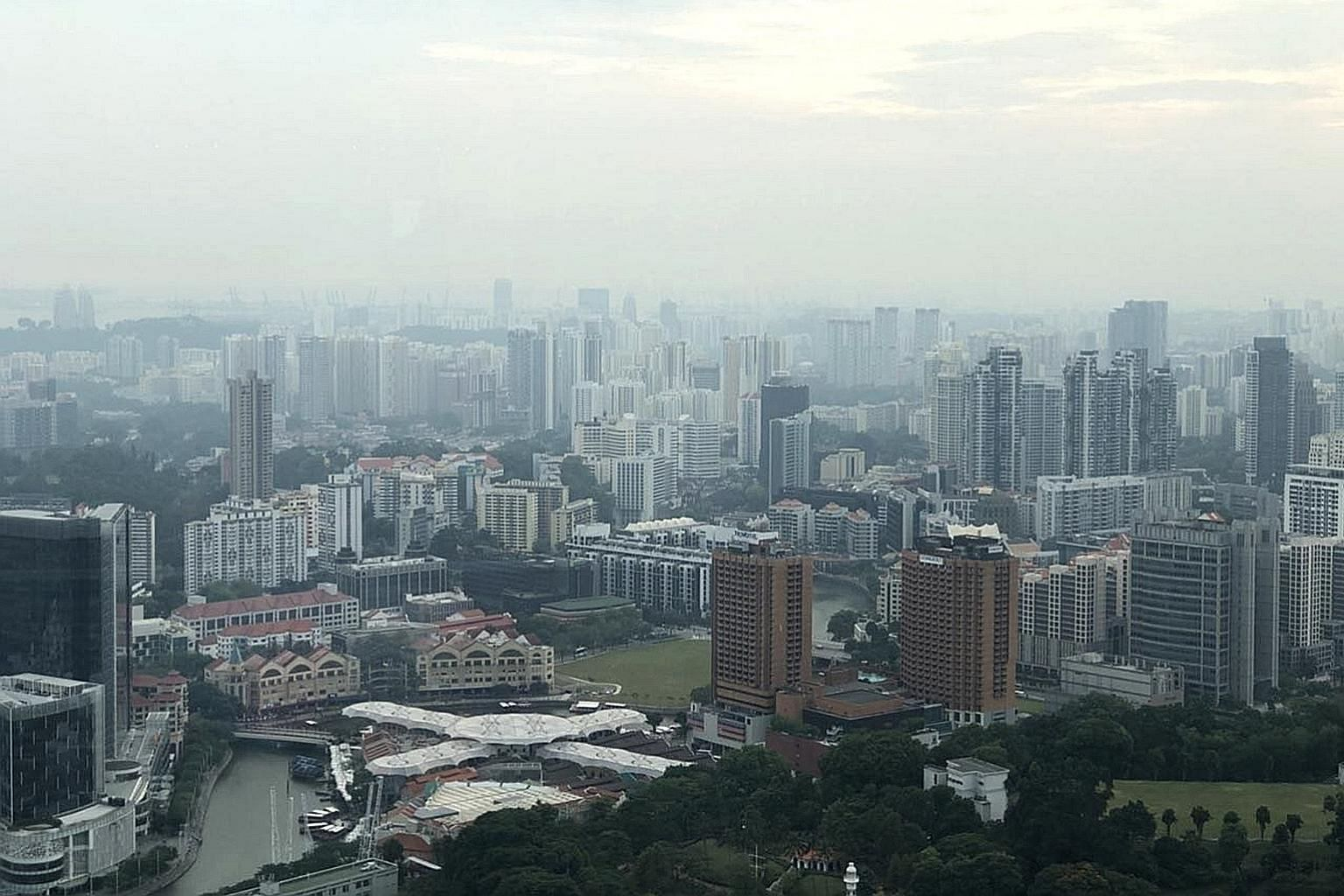 """The view from Equinox on level 70 of Swissotel yesterday. NEA said it had detected """"a hot spot with dense smoke plume in the south-eastern part of Johor"""" in the afternoon."""