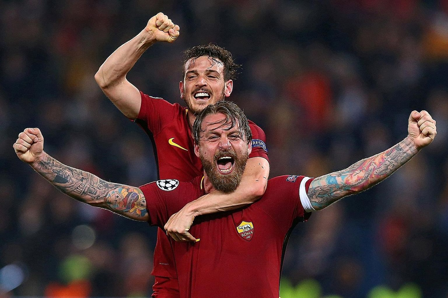 Roma captain Daniele de Rossi (front) and team-mate Alessandro Florenzi celebrating after stunning Barcelona 3-0 in the Champions League quarter-final second leg to advance 4-4 on the away-goal rule.