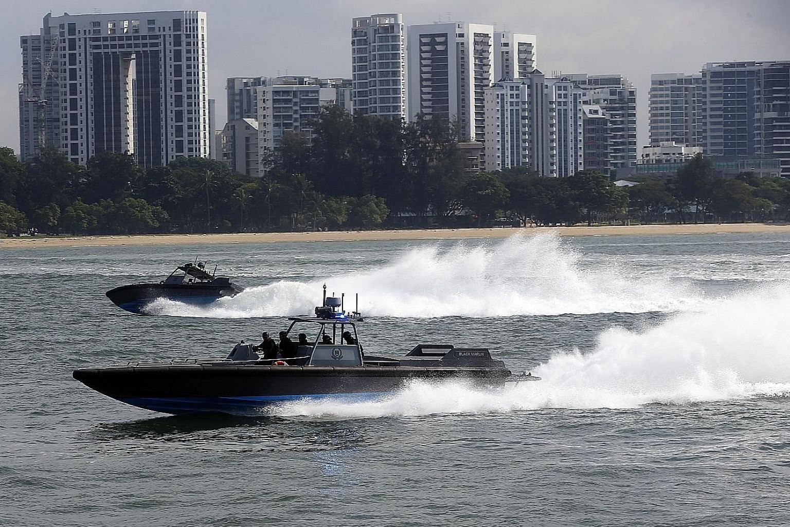 The Police Coast Guard's PK-class high-speed interceptors in action. The 14 cases include actual and attempted incidents. One was an incident of piracy in the high seas and the rest were armed robberies against ships in coastal waters and anchorages.