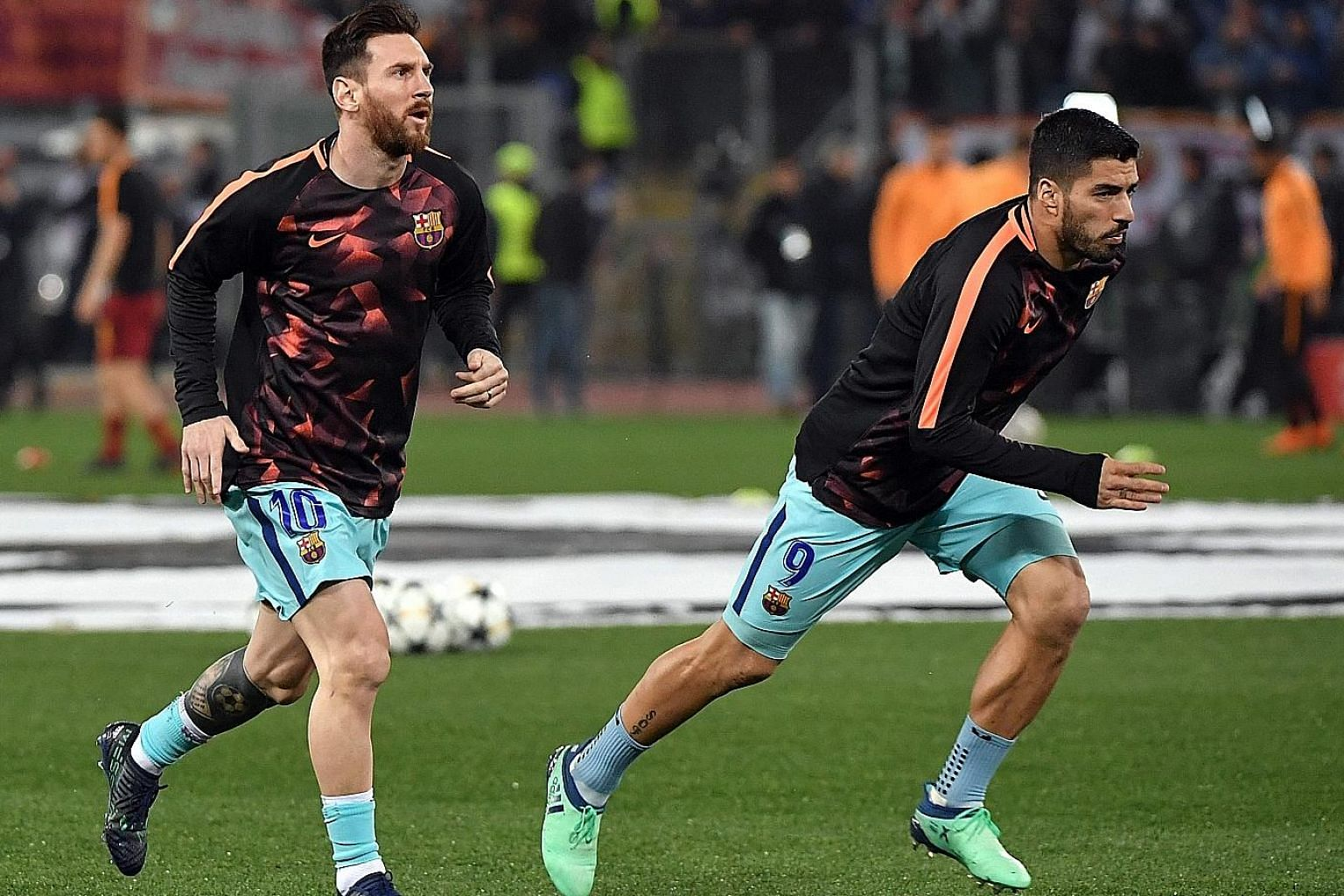 Barcelona's Lionel Messi (far left) and Luis Suarez warming up for Tuesday's Roma game. Manager Ernesto Valverde has challenged the side to rebound from their Champions League exit and attempt to win the LaLiga and King's Cup double.