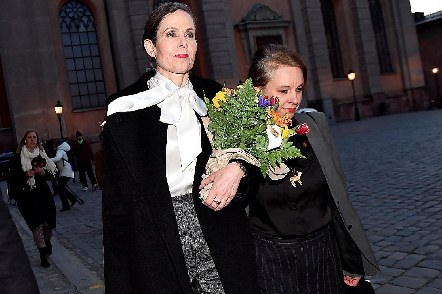 Former permanent secretary Sara Danius (left) on the day of her resignation, leaving the academy with member Sara Stridsberg. She had failed to receive support for reforms in the wake of the scandal.