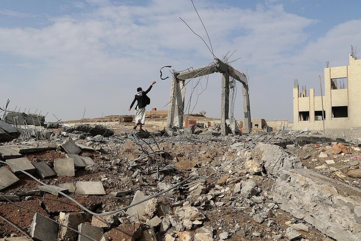 The ruins of a community college after an air strike in Saada, Yemen, last week. Democratic states are not more likely than their autocratic counterparts to employ air-only campaigns, but rich states - and by extension, militarily powerful states - a