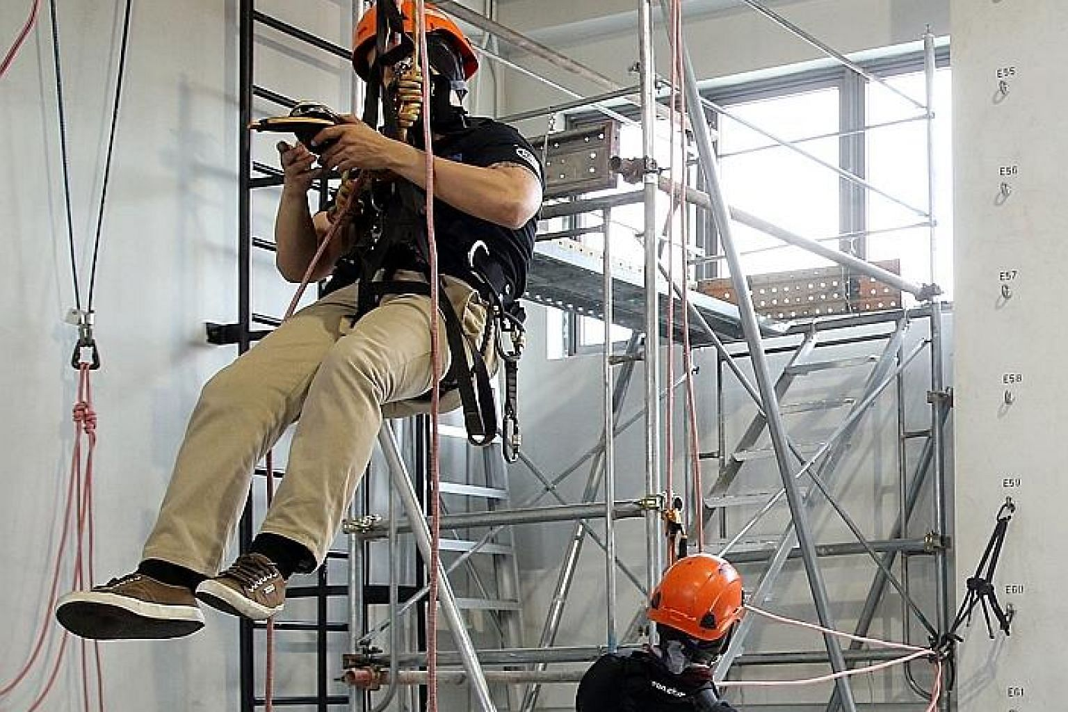 Rope-access training at D-Ocean. Demand for rope-access workers may rise as building owners look to replace non-compliant cladding.