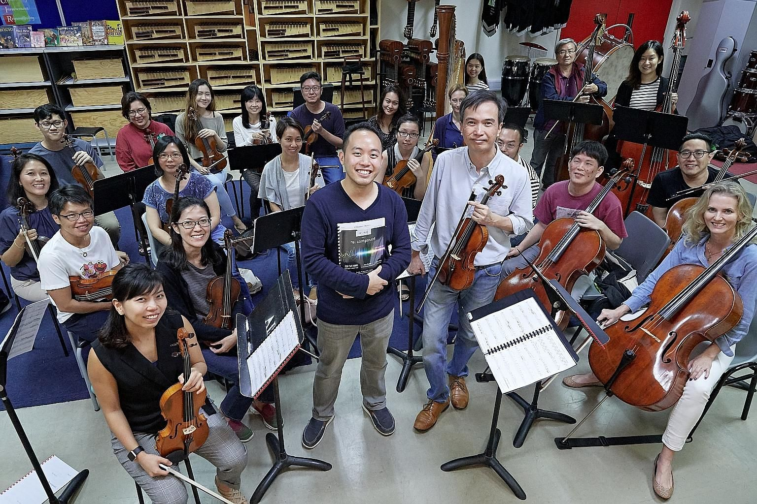 Home-grown chamber orchestra re: mix, led by its music director Foo Say Ming (standing, right), will perform the P. Ramlee Suite composed by Julian Wong (standing, left).