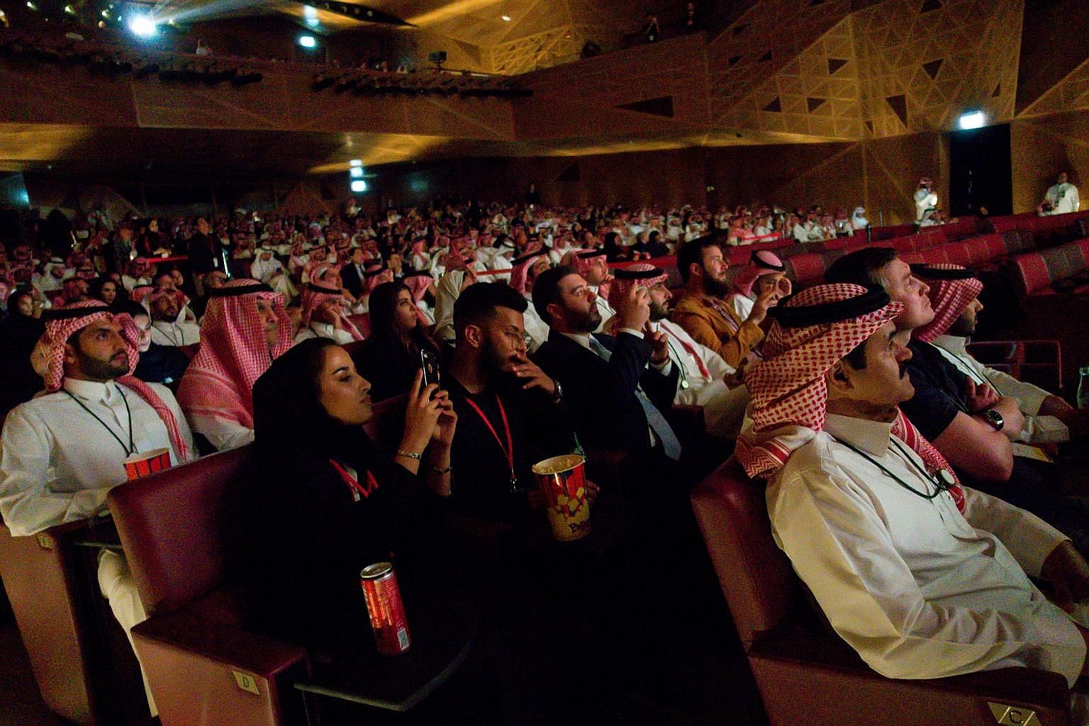 Saudis enjoying a VIP screening of Black Panther in Riyadh on Wednesday. AMC Entertainment, which opened the theatre, plans to open at least 40 cinemas in 15 Saudi cities in the next three to five years.