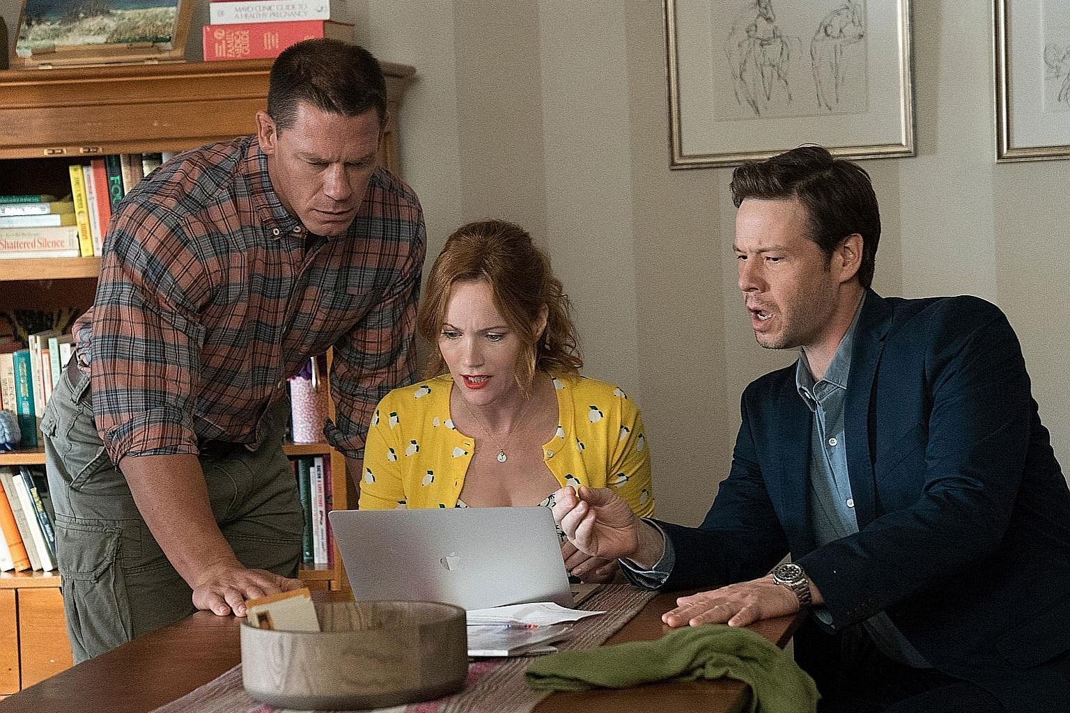 (Above from left) John Cena, Leslie Mann and Ike Barinholtz play anxious parents in Blockers.