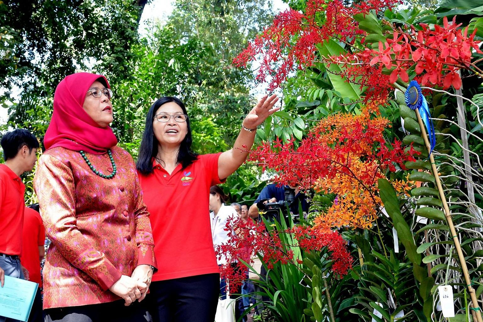 President Halimah Yacob with National Orchid Garden deputy director Whang Lay Keng at the opening of the inaugural Singapore Garden Festival Orchid Show.