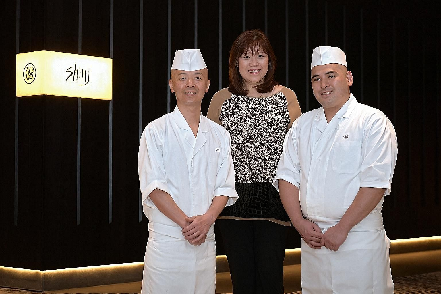 Summer Pavilion's Chinese executive chef Cheung Siu Kong believes an integral part of culinary success lies in honing basic cooking techniques, such as heat control. Master chef Koichiro Oshino (left), Mrs Joni Ong and chef Shunsuke Yoshizawa. Mr Jim