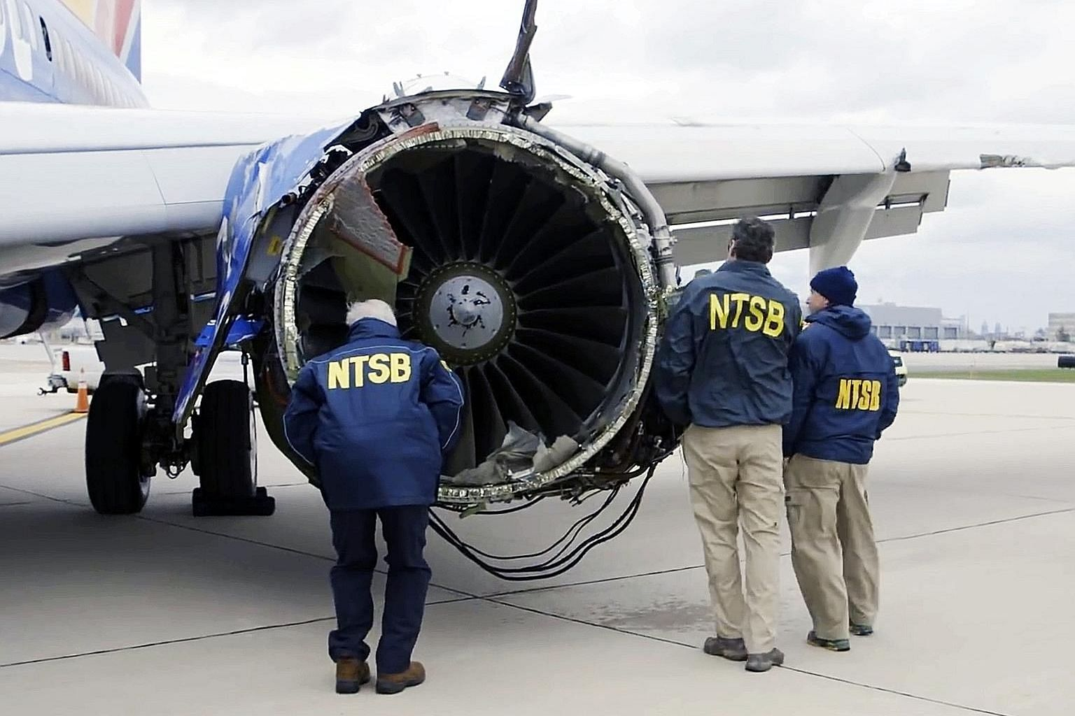 Investigators examining the damaged engine of the Southwest Airlines plane involved in last week's accident. The engine had blown apart, killing a passenger and forcing an emergency landing.
