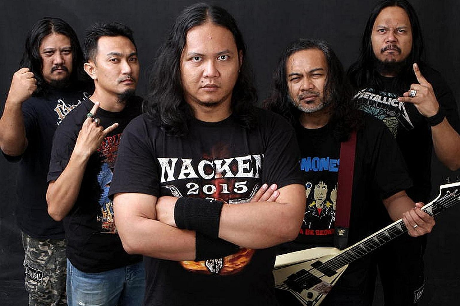Mr Mustafa Kamal Abdul Rahman (second from left) with his band mates. The drummer in heavy metal band Farasu since 2002, he was nominated by Parti Keadilan Rakyat to contest in Negeri Sembilan's Labu state.
