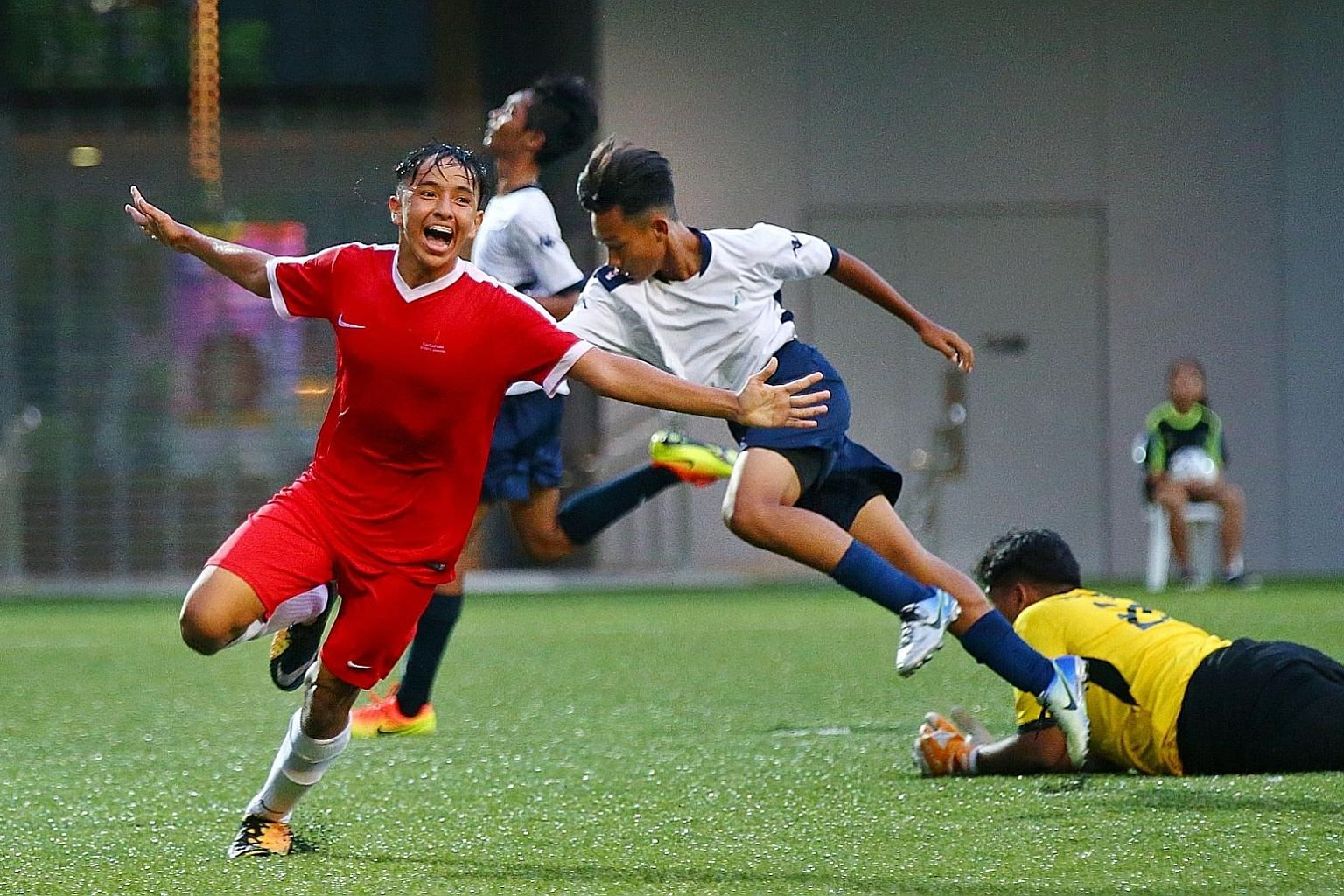 Sports School's Fathullah Rahmat wheeling away in joy after scoring their second goal in the final of the B Division Football Schools Premier League 1. They beat Meridian 2-0 at Our Tampines Hub to retain their title.