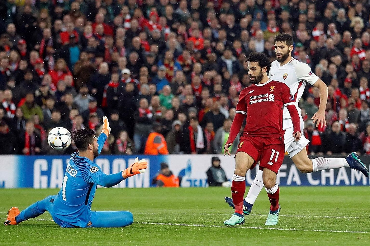 Liverpool's Mo Salah chips the ball over Roma goalkeeper Alisson Becker for the Reds' second goal in the 5-2 rout of his former club in the first leg of the Champions League semi-final.
